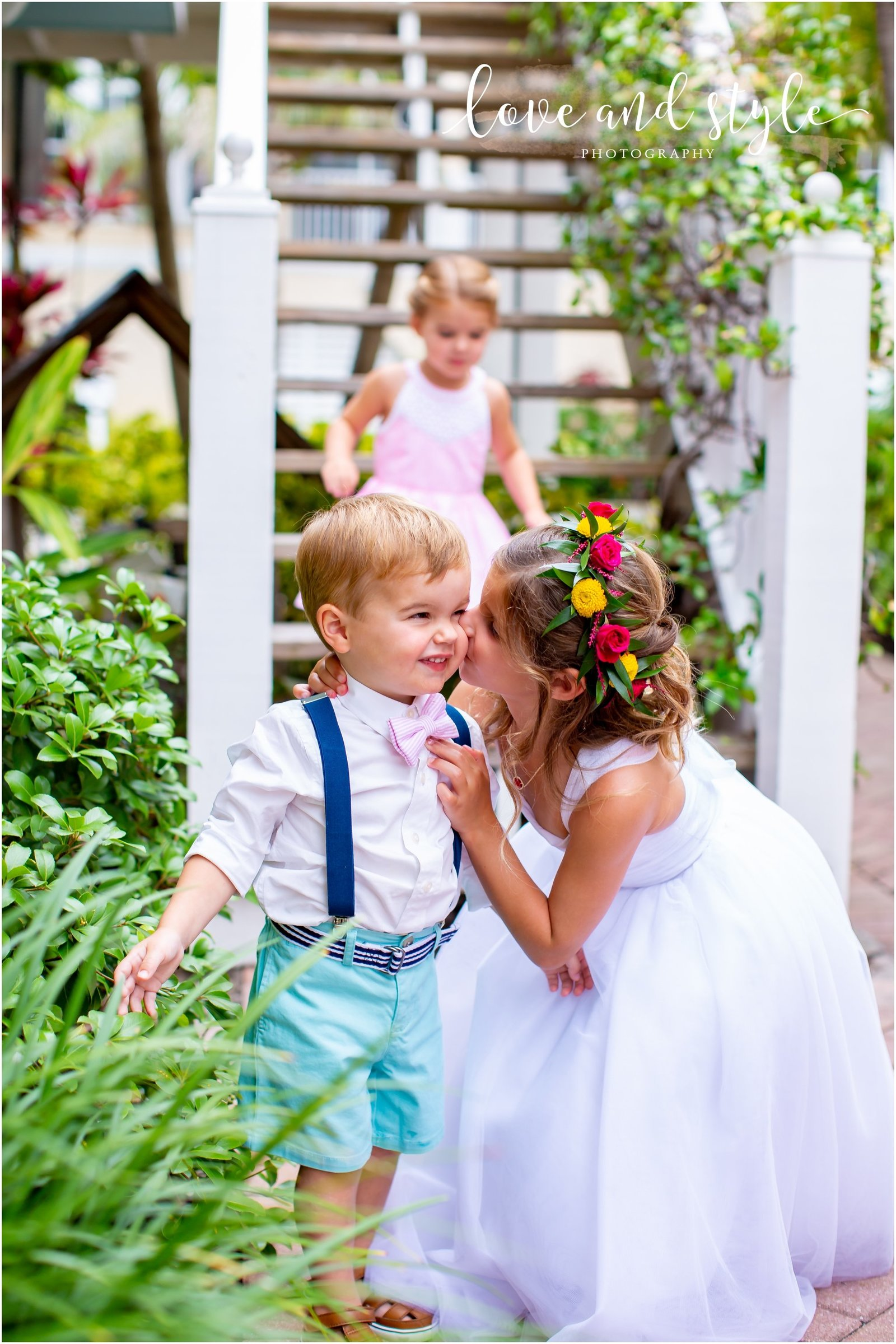 Flower Girl kissing the Ring Bearer at The Tortuga Inn, Anna Maria Island