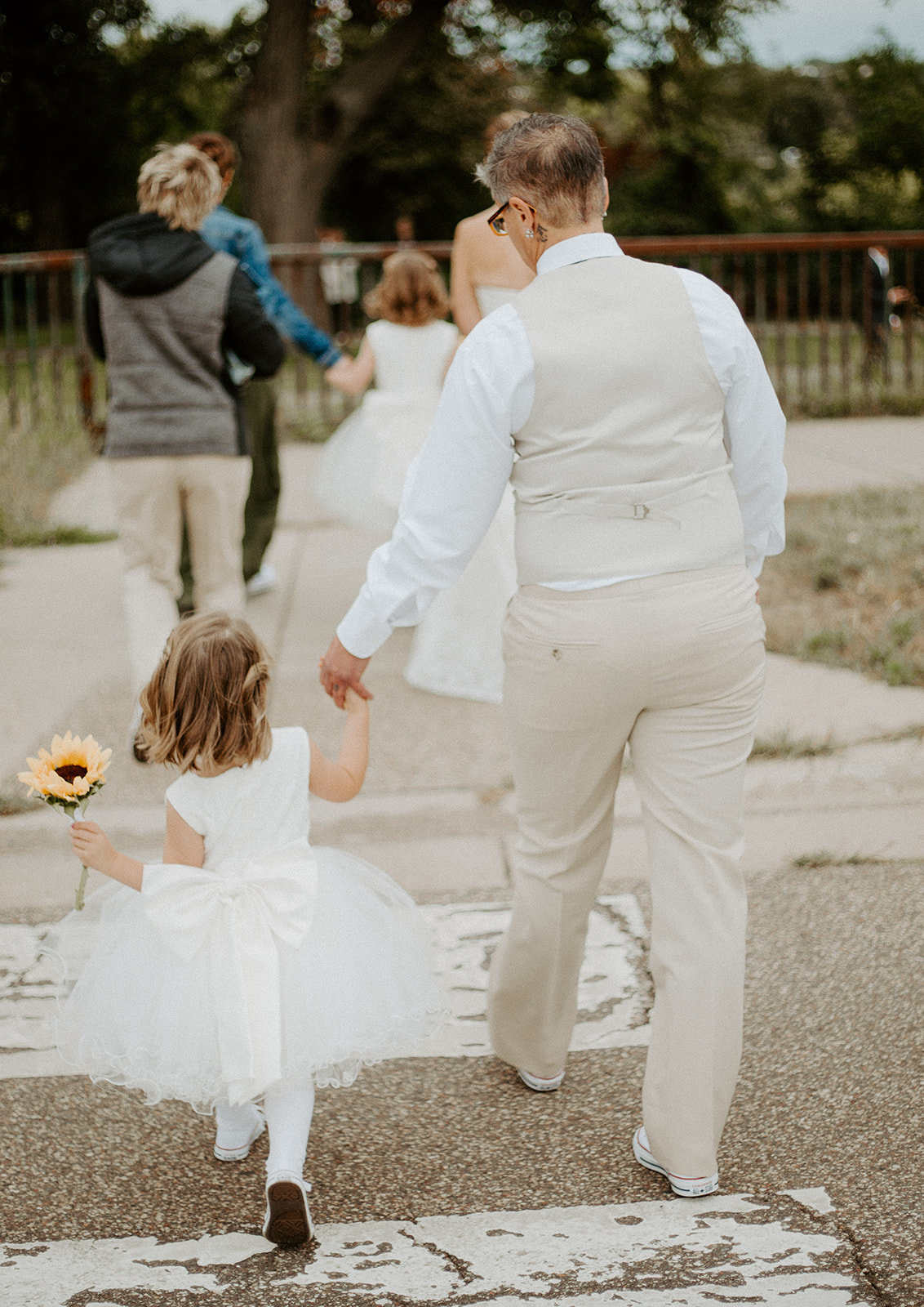 Flower girl walking across the street during a Minneapolis wedding