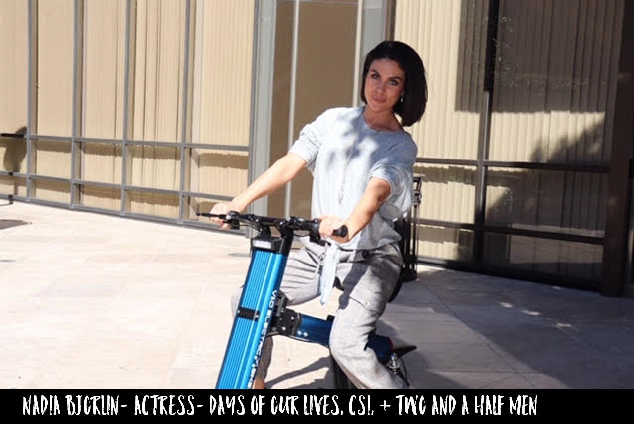 Actress Nadia Bjorlin cruising around the streets of LA on a Blue Go-Bike M2
