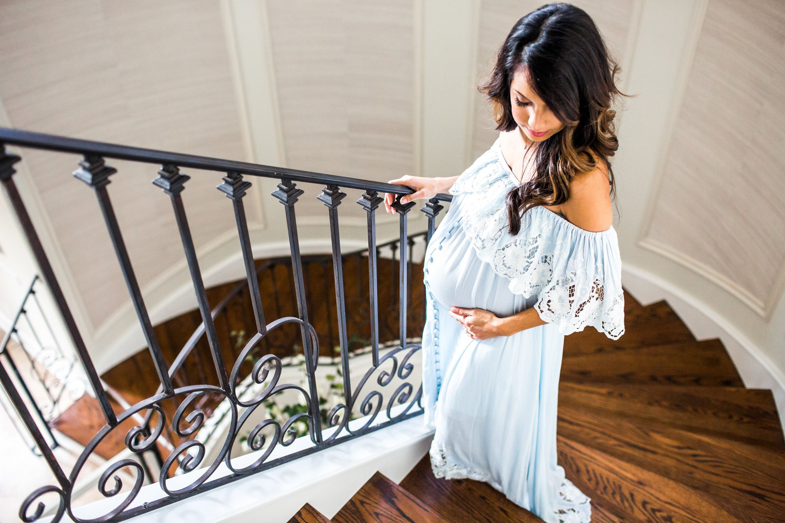 Maternity pictures on staircase in bohemian off the shoulder dress
