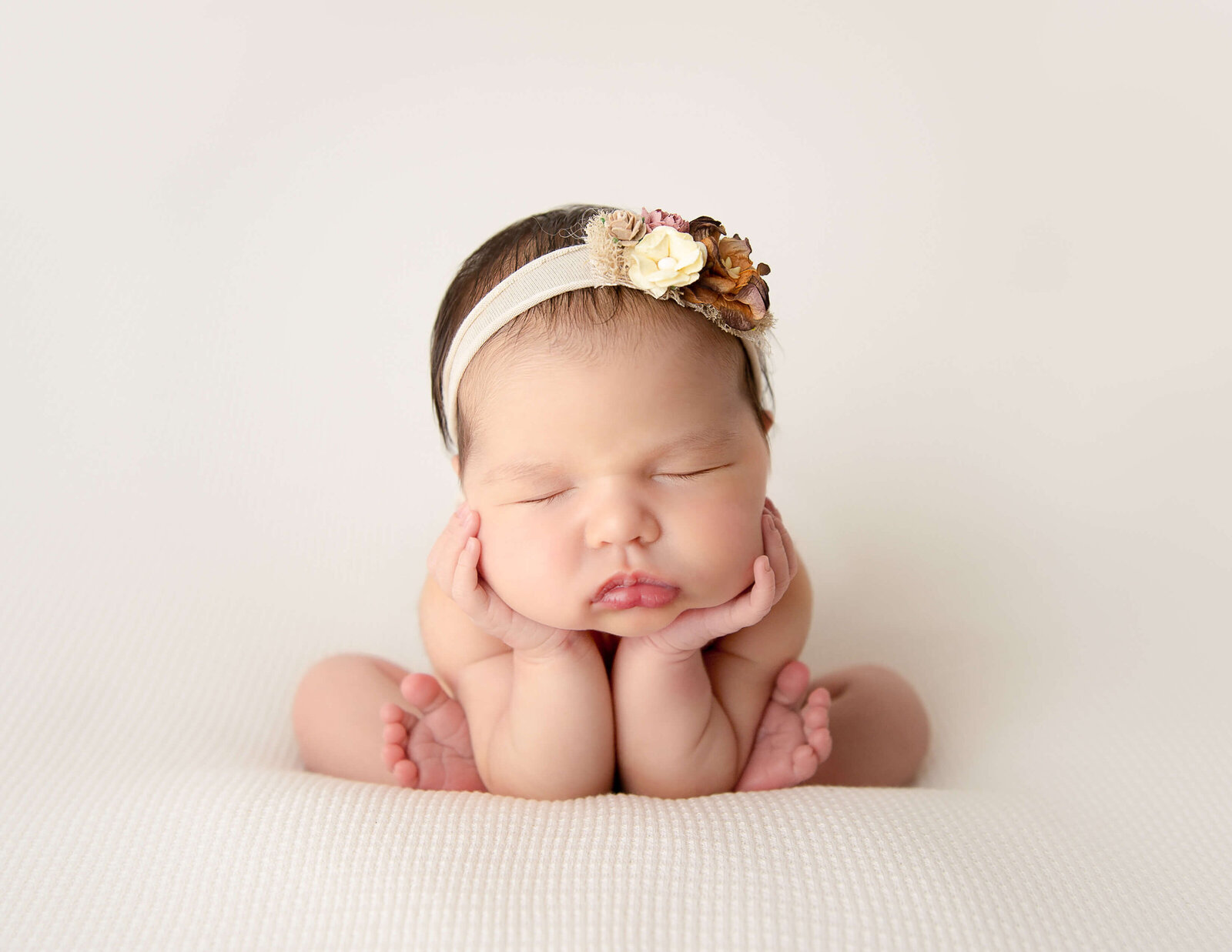 Froggy posed newborn at our studio.
