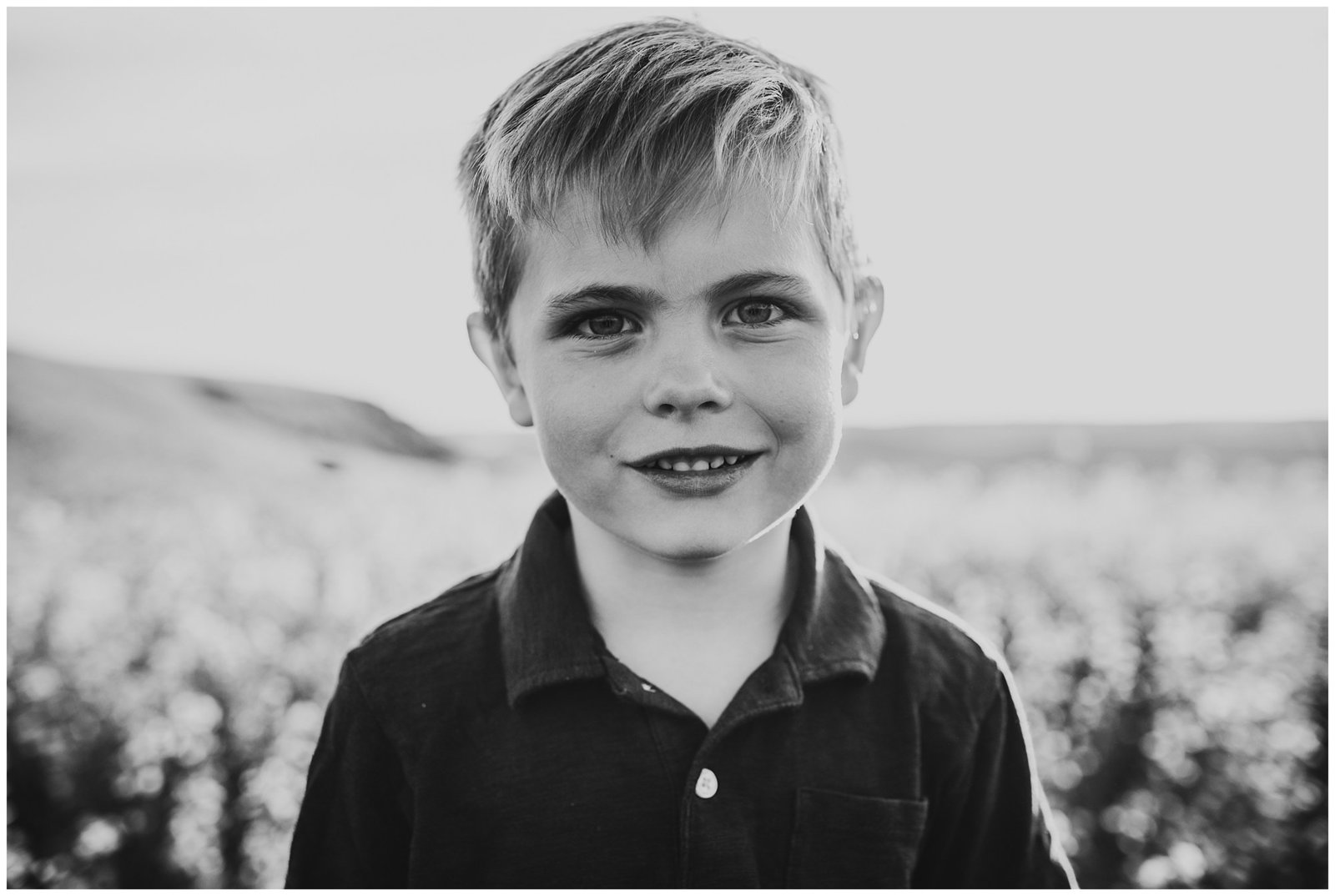 black and white image of little boy in field Emily Ann Photography Seattle Family Photographer