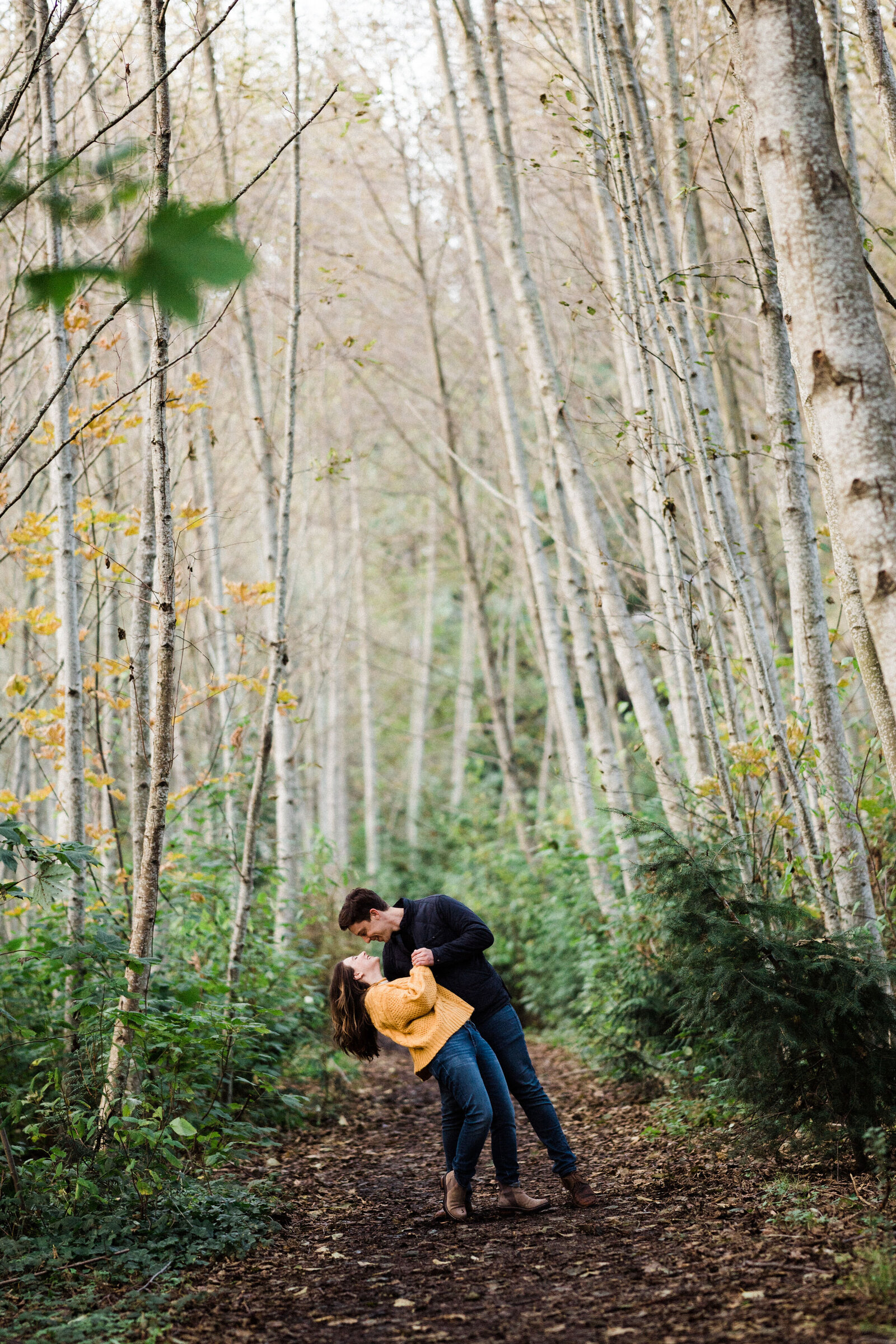 Birch trees make the mood romantic and intimate at best spot for engagement photos in Seattle, forests of Discovery Park