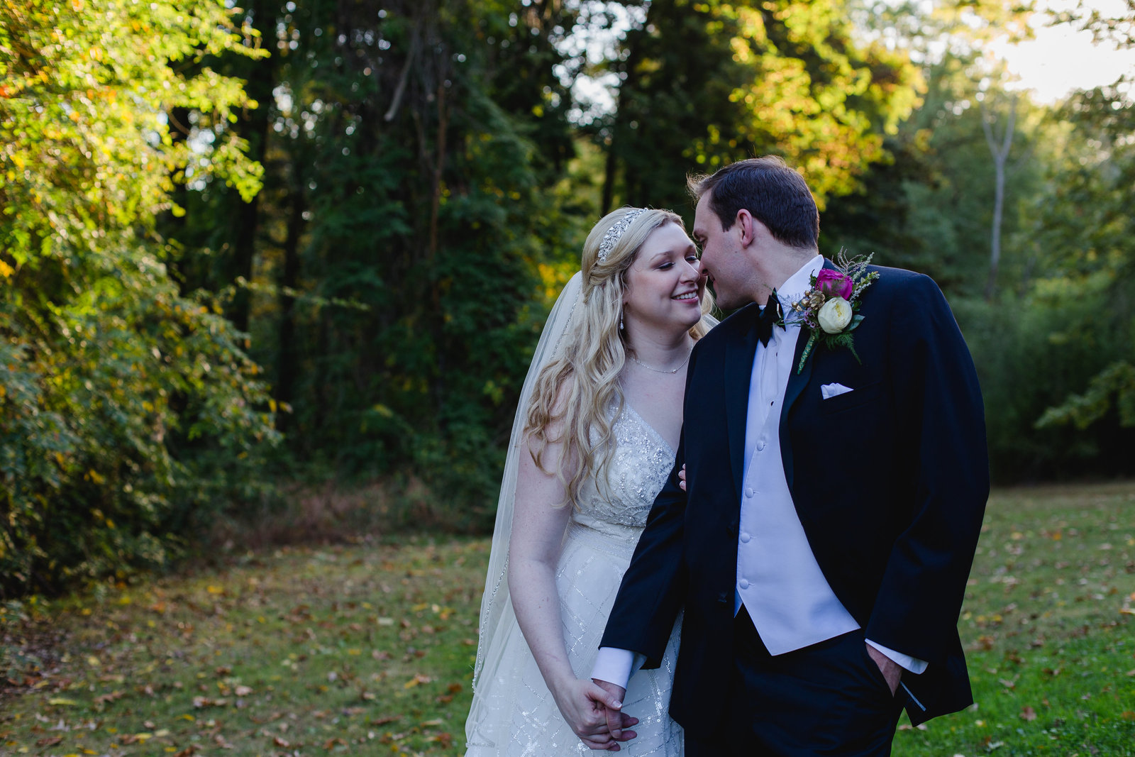a bride and groom share a snuggle on the lawn of pittsburgh's springwood conference center