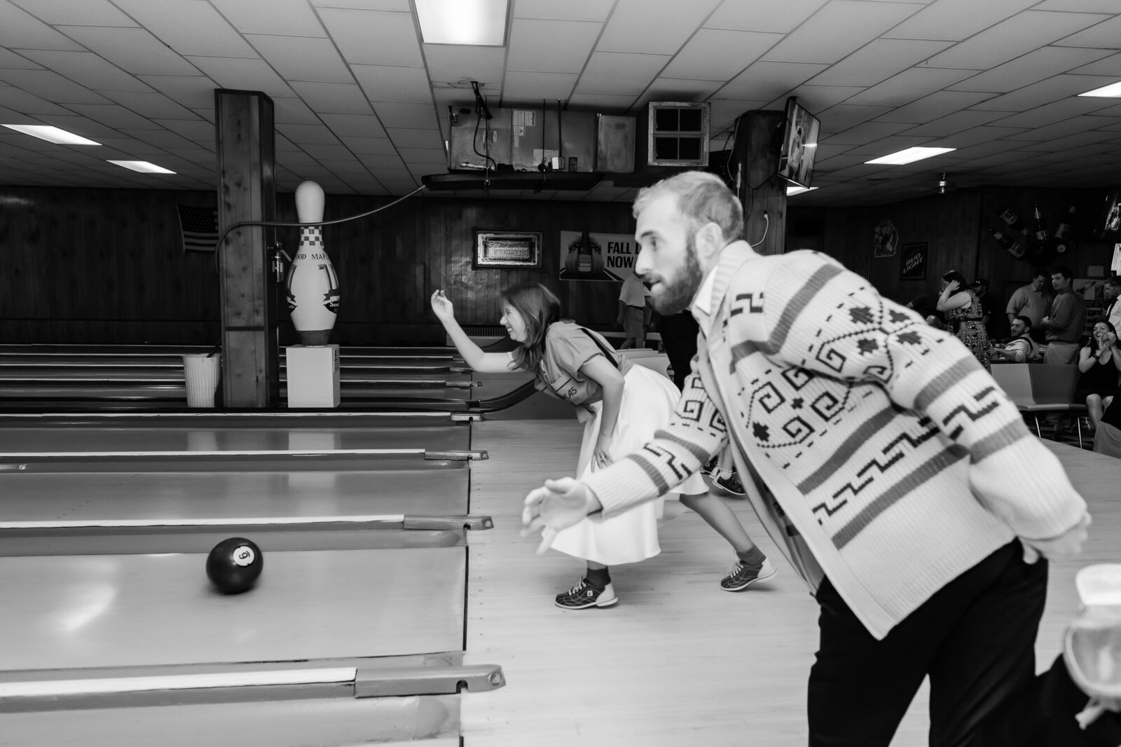 Bride and groom bowling at their nontraditional bowling wedding in St. Louis