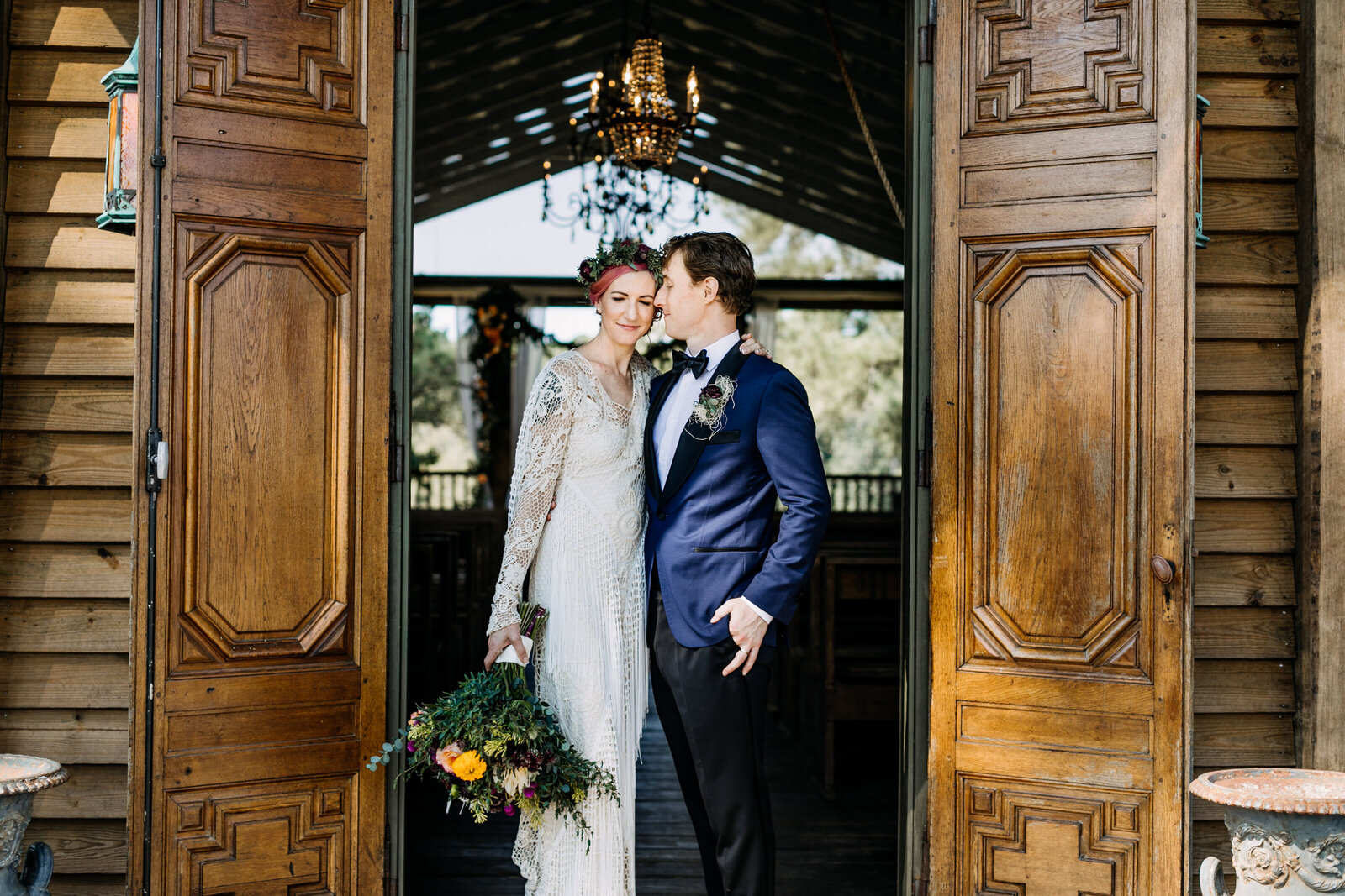 bride and groom vintage church doors