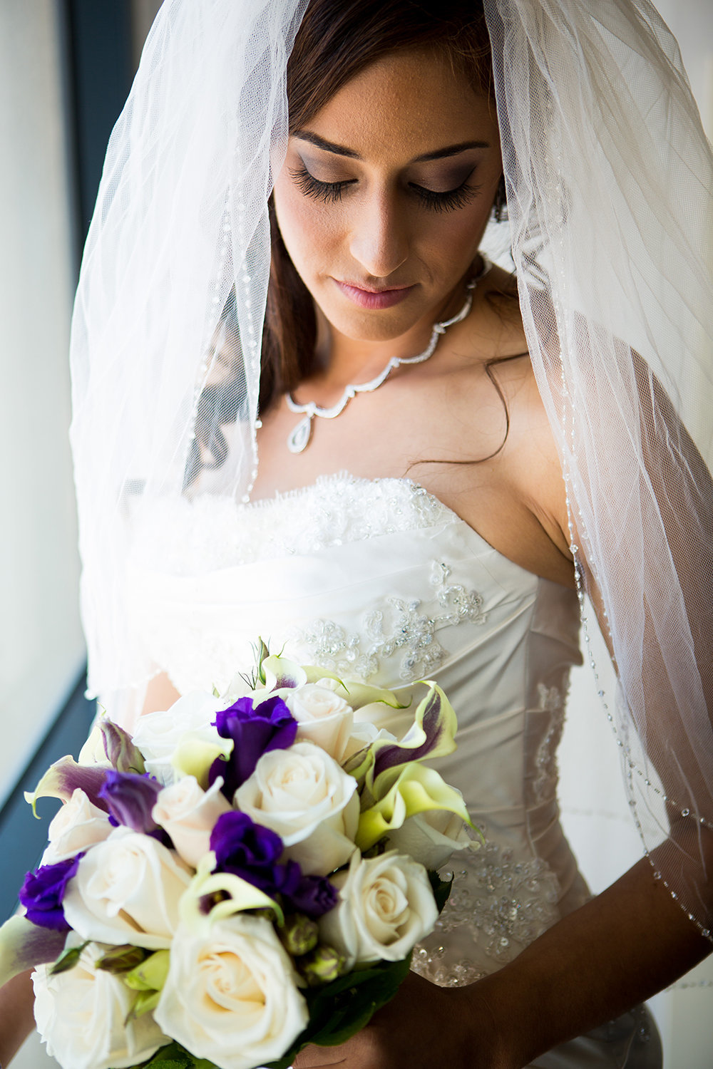 Pensive moment with purple flowers and white roses.
