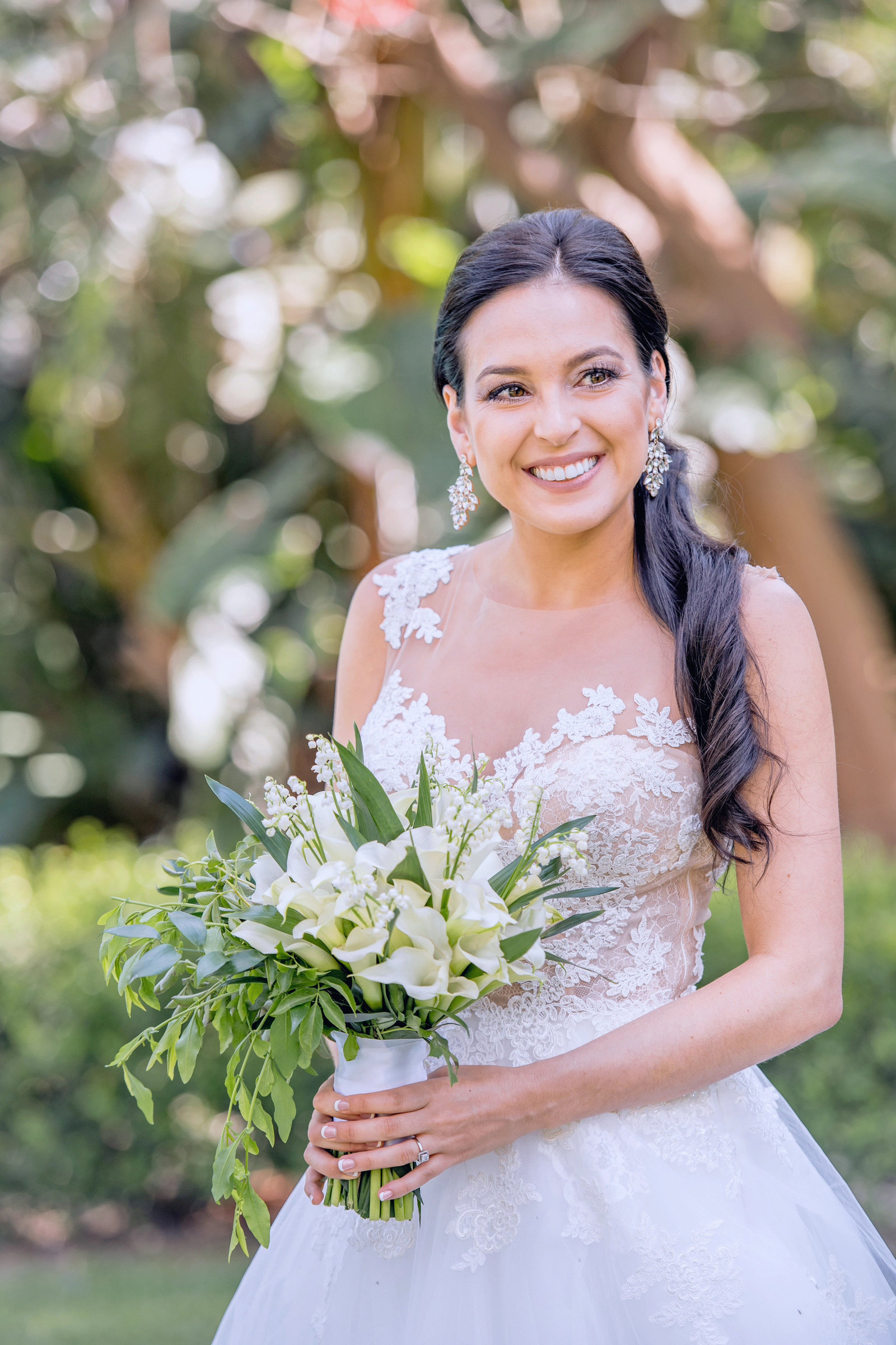 bride posing with her bouquet at the newhall mansion