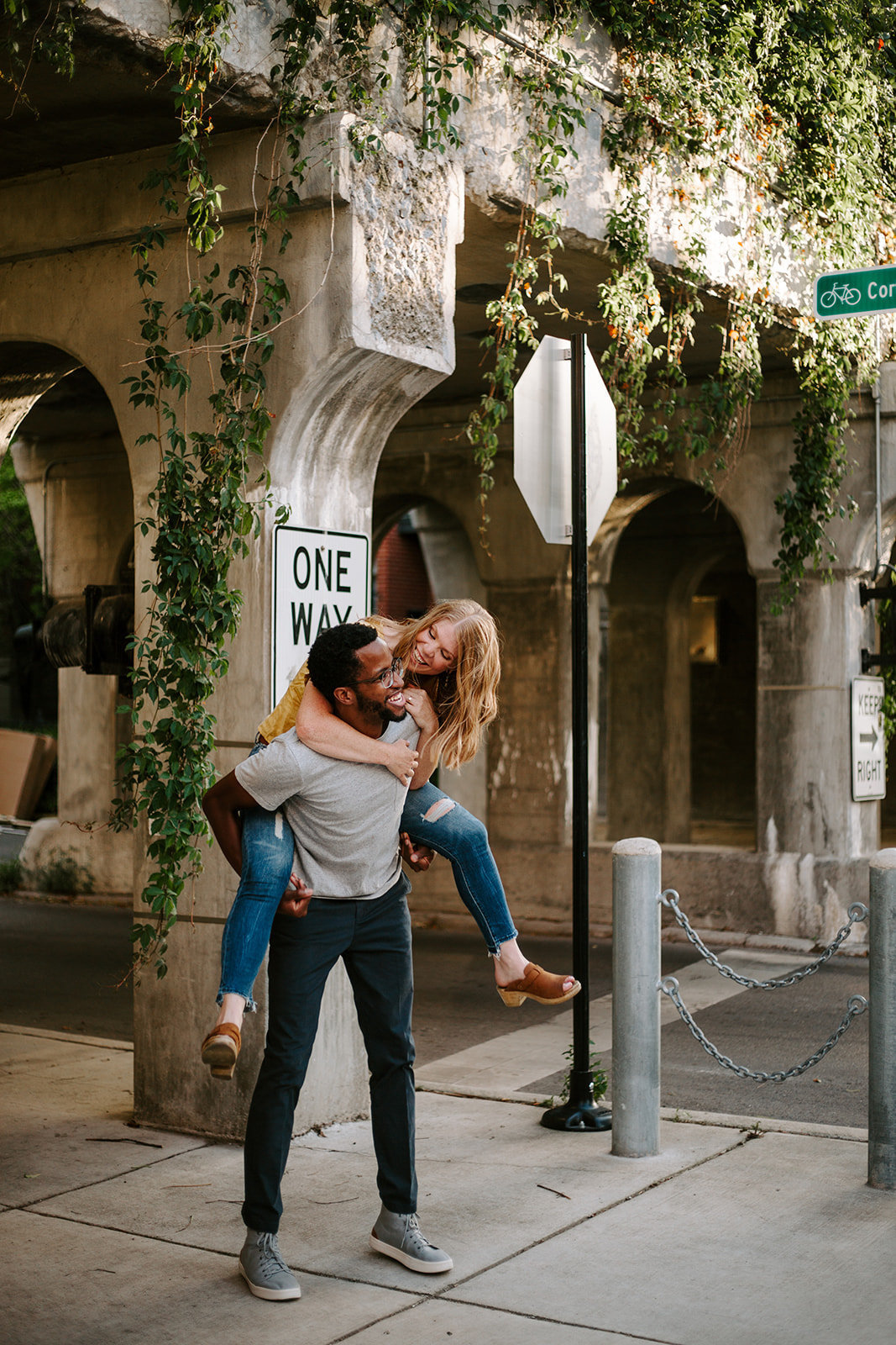 Couple doing a piggy back ride during the streets of Chicago during their engagement session