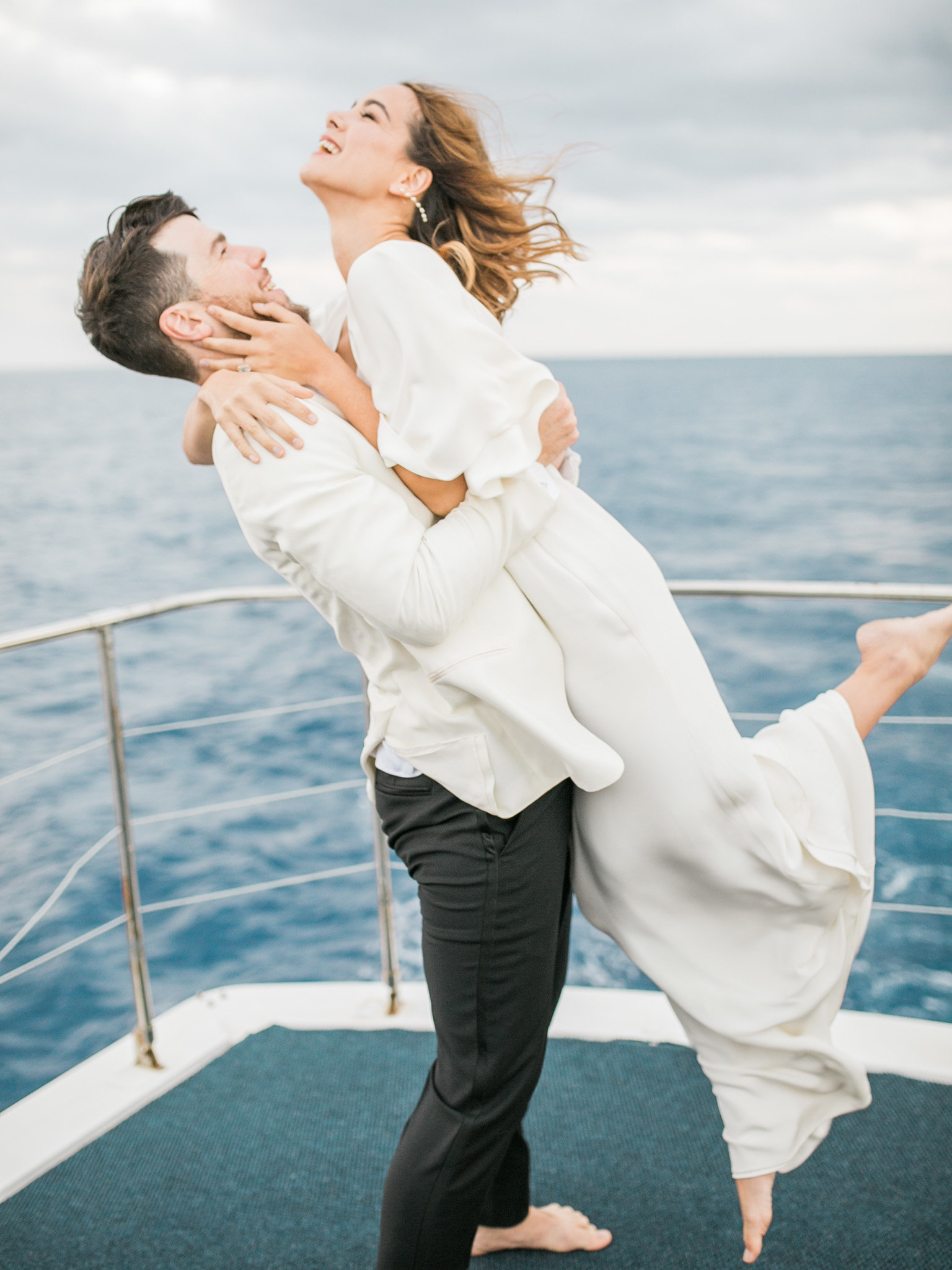 Bride and groom on a yacht san diego bay