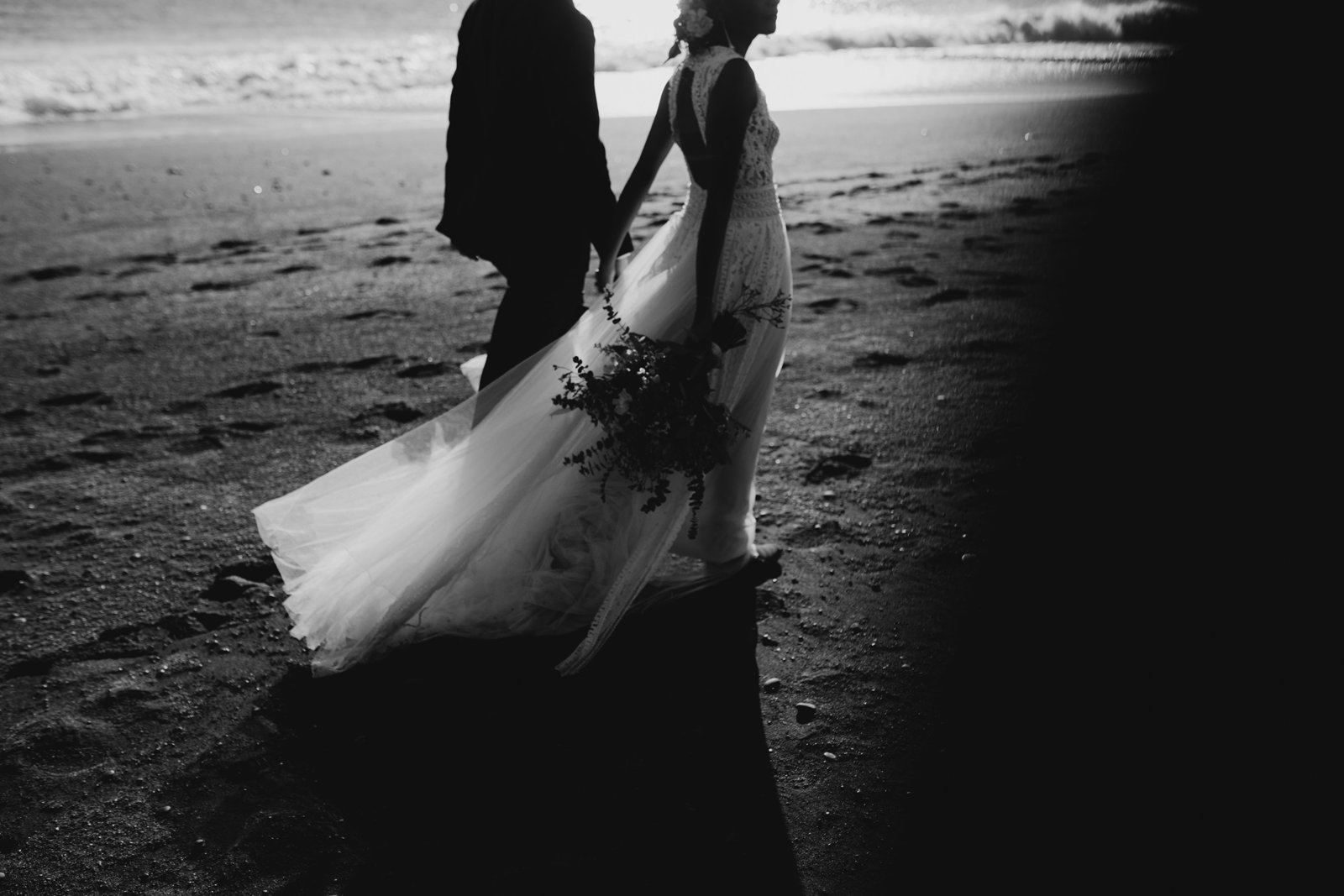 romantic interracial elopement at icelands black sand beach