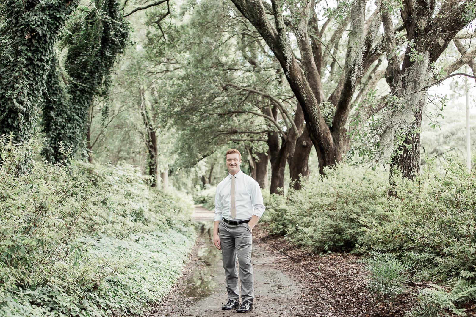 Groom poses under trees, Hampton Park, Charleston, South Carolina