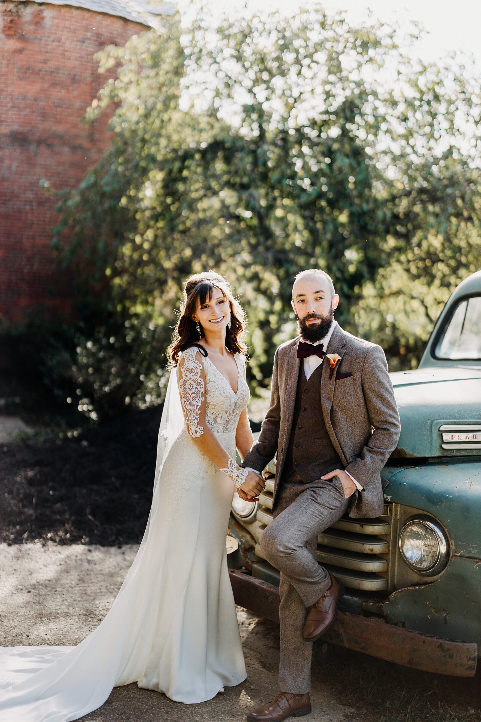 bride and groom with vintage truck
