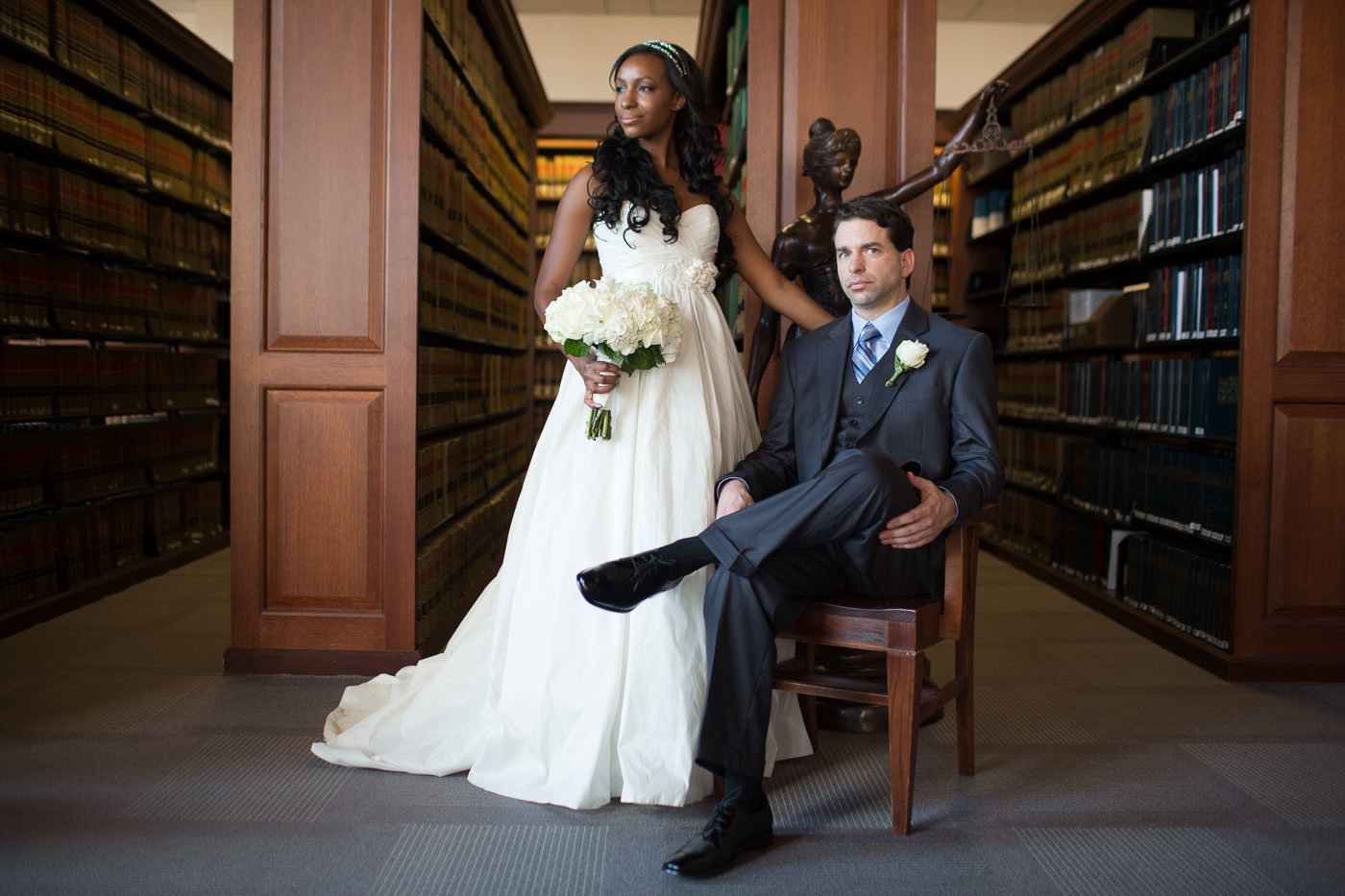 wedding couple posing in library for portraits St Louis Pinxit Photo