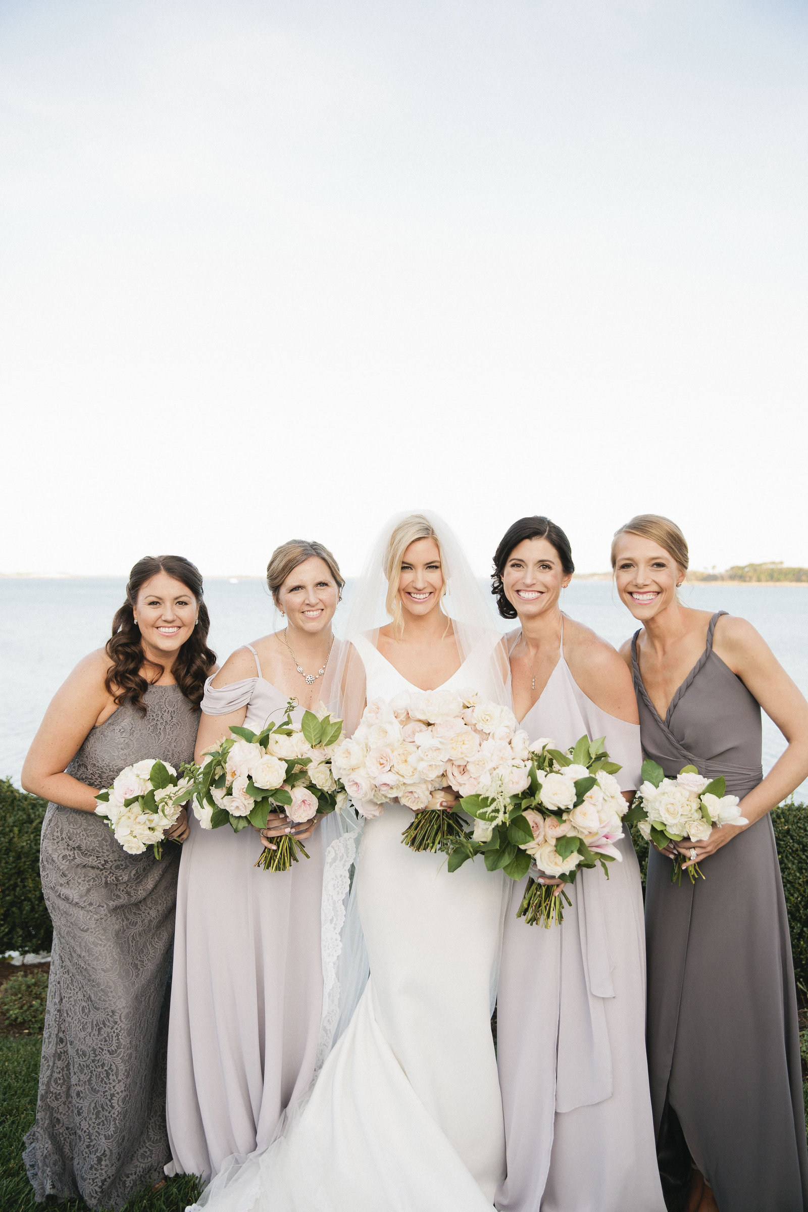 Whitney Bischoff and her bridesmaids in gray bridesmaids dresses