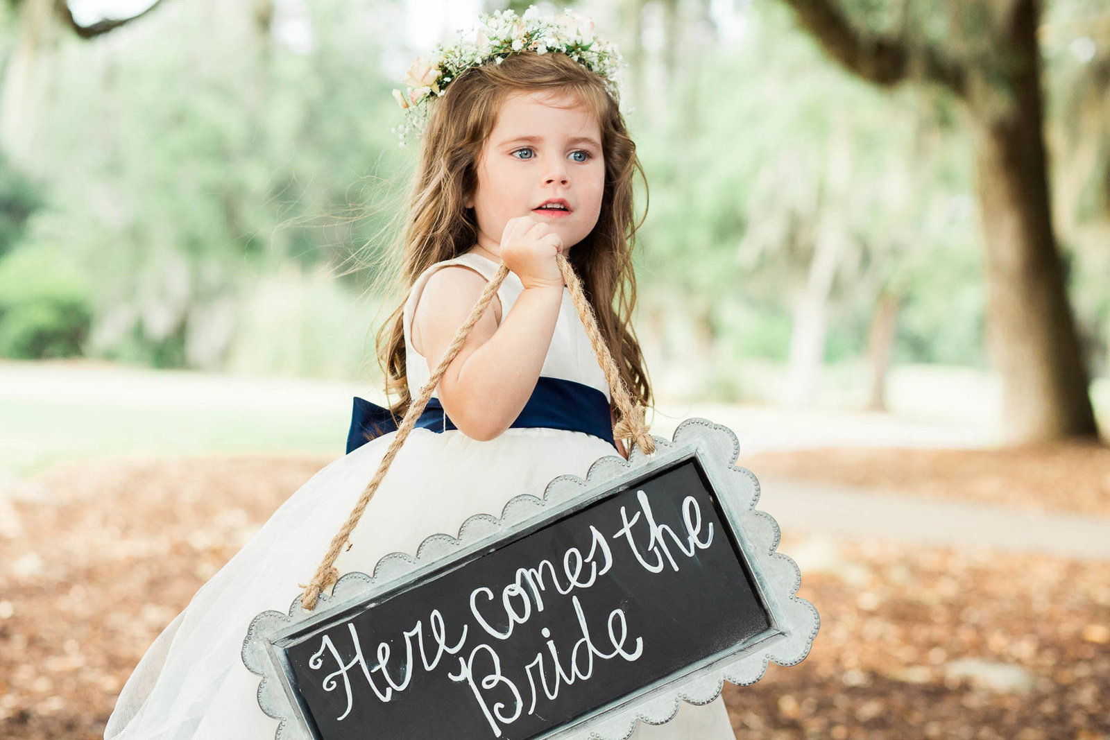 Flower girl walks down the aisle, Dunes West Golf and River Club, Mt Pleasant, South Carolina. Kate Timbers Photography.