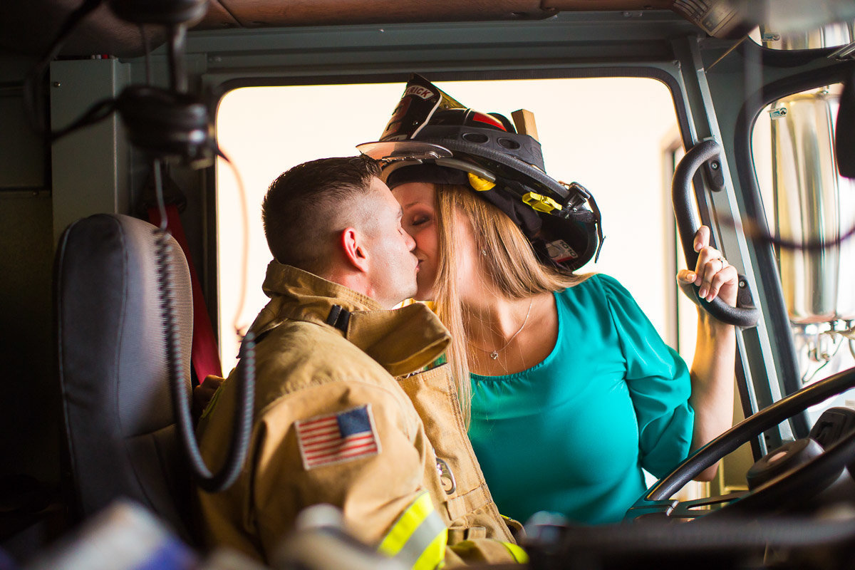 bride and groom on a firetruck in maryland for their wedding