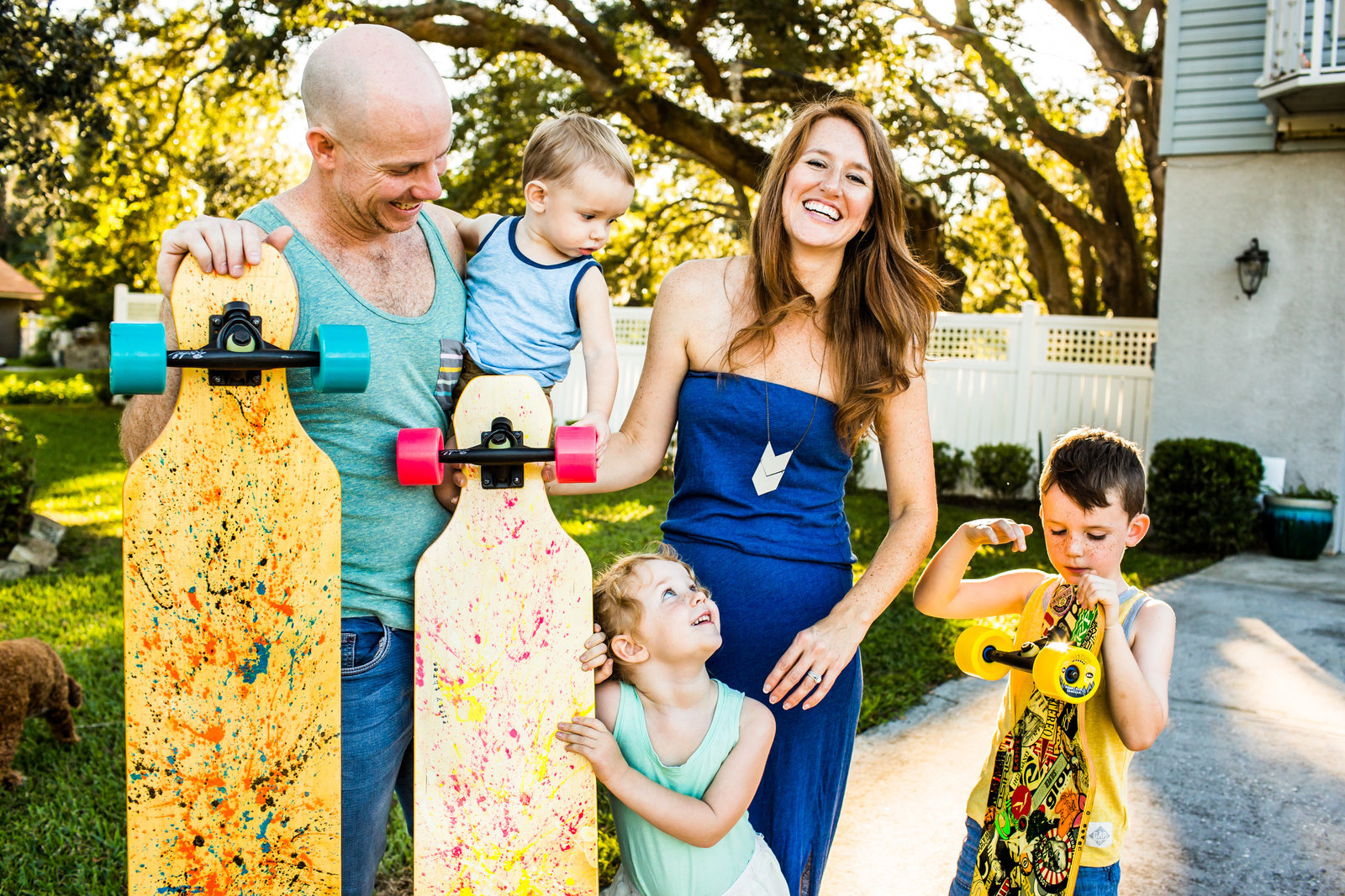 Unique family portraits with skateboards and tanks