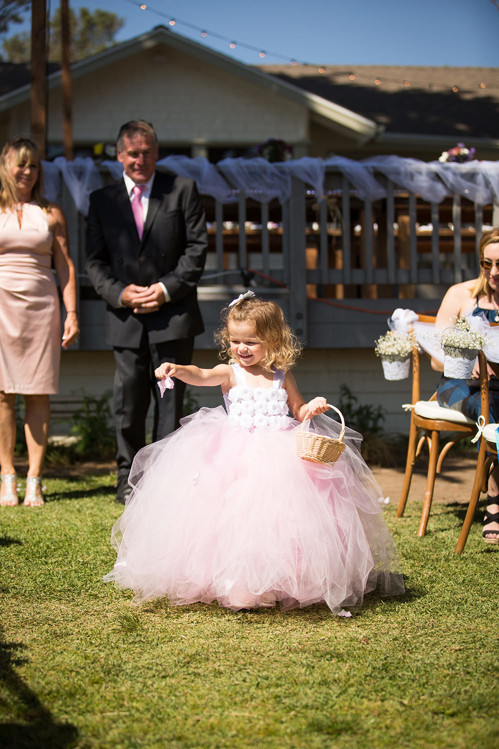 flower girl walking down the aisle at martin johnson house