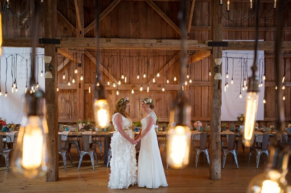 Gorgeous rustic tablescape for barn wedding with Edison Bulb light installation at The Barn on Walnut Hill