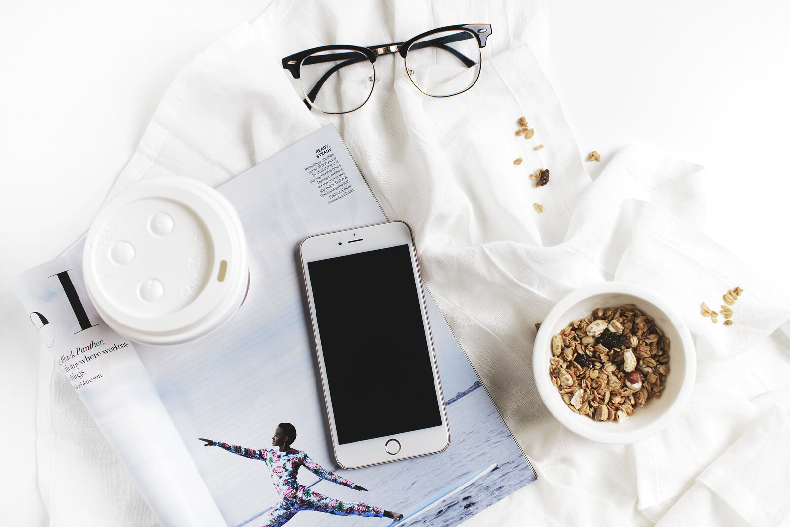 coffee, iphone, glasses, small business owner workspace