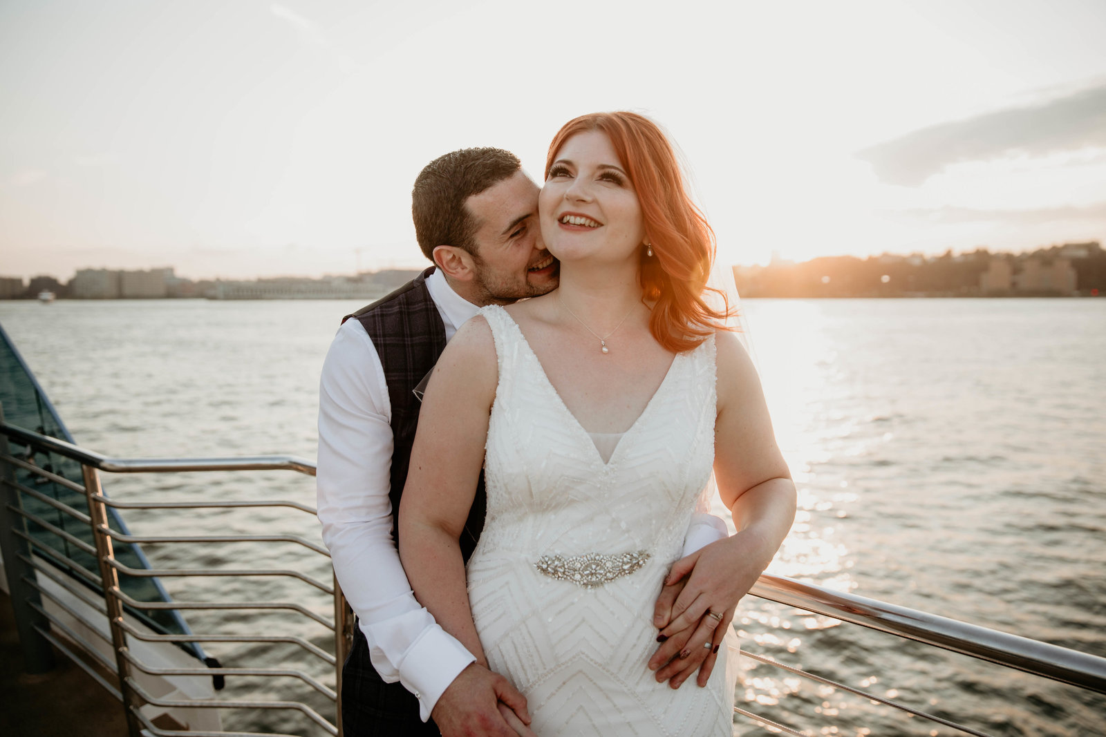 Bride and groom at sunset on the Hudson River.