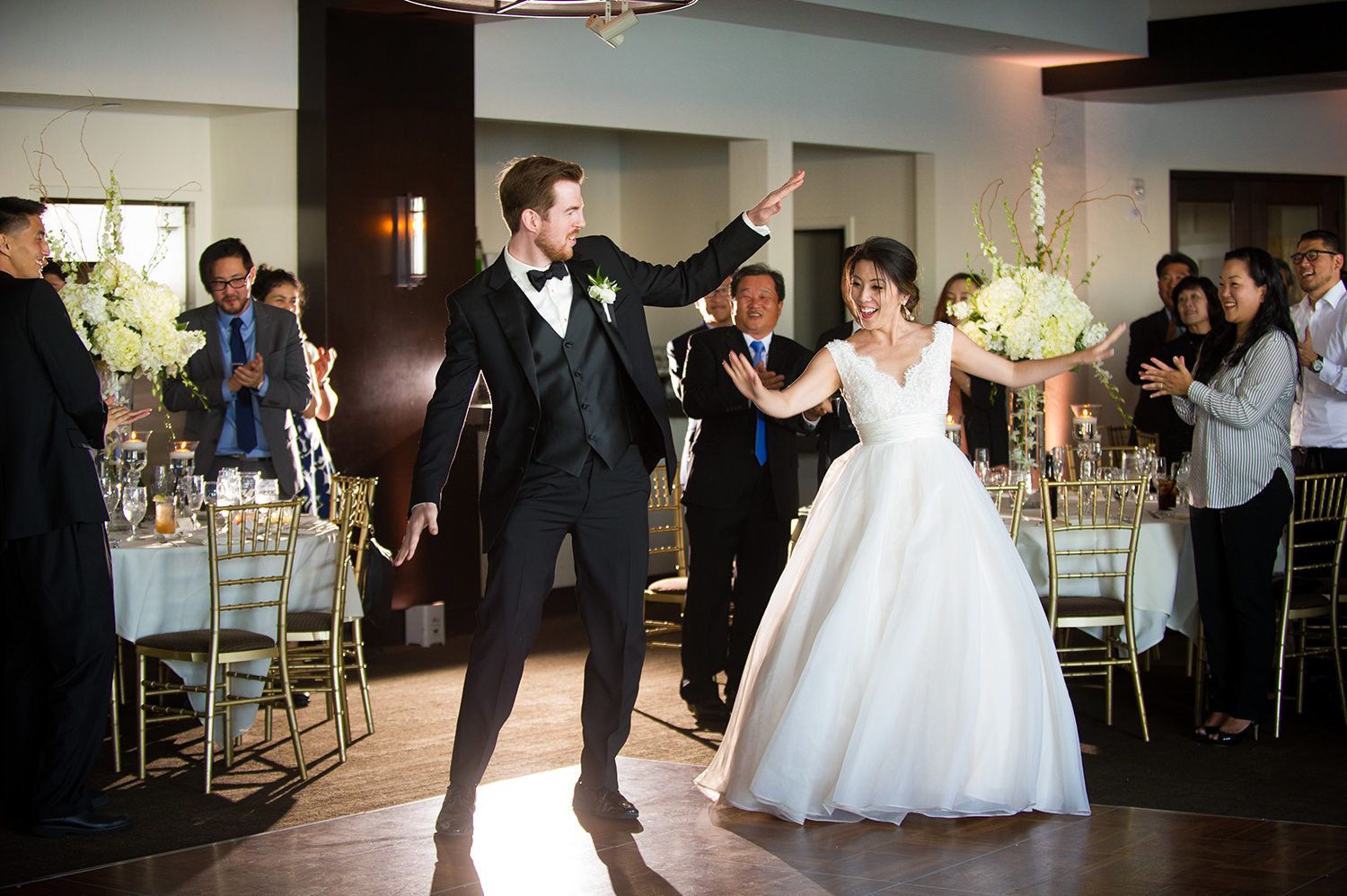 bride and groom dancing a fun first dance