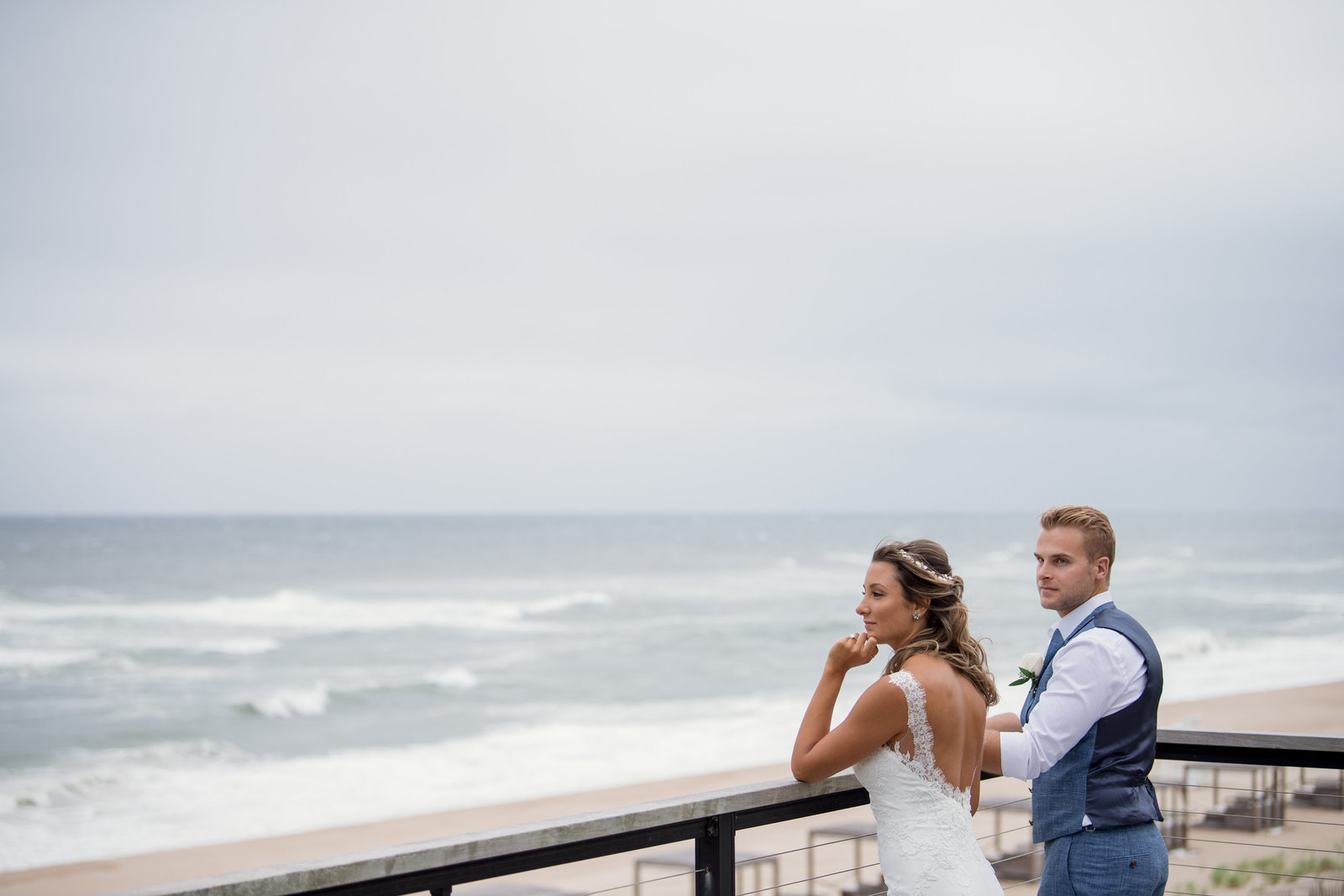 photo bride and groom looking into the ocean at Gurneys Montauk Resort wedding