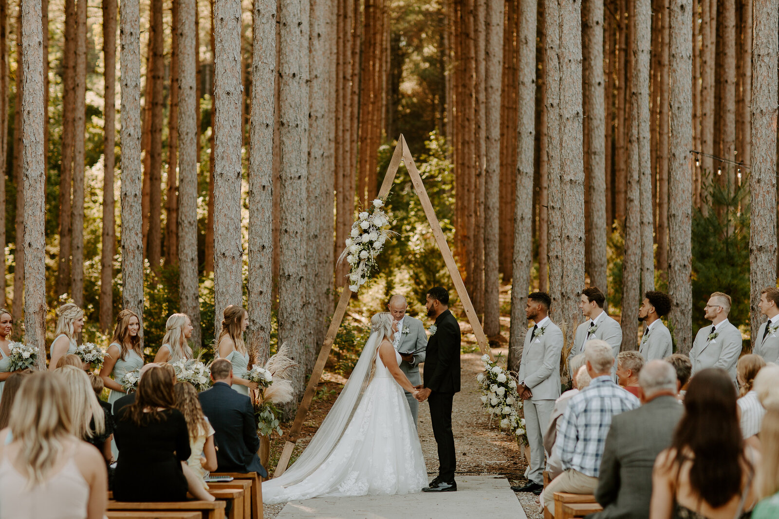 Ceremony at Cambridge Minnesota's Pinewood Event Center captured by Skyler and Vhan