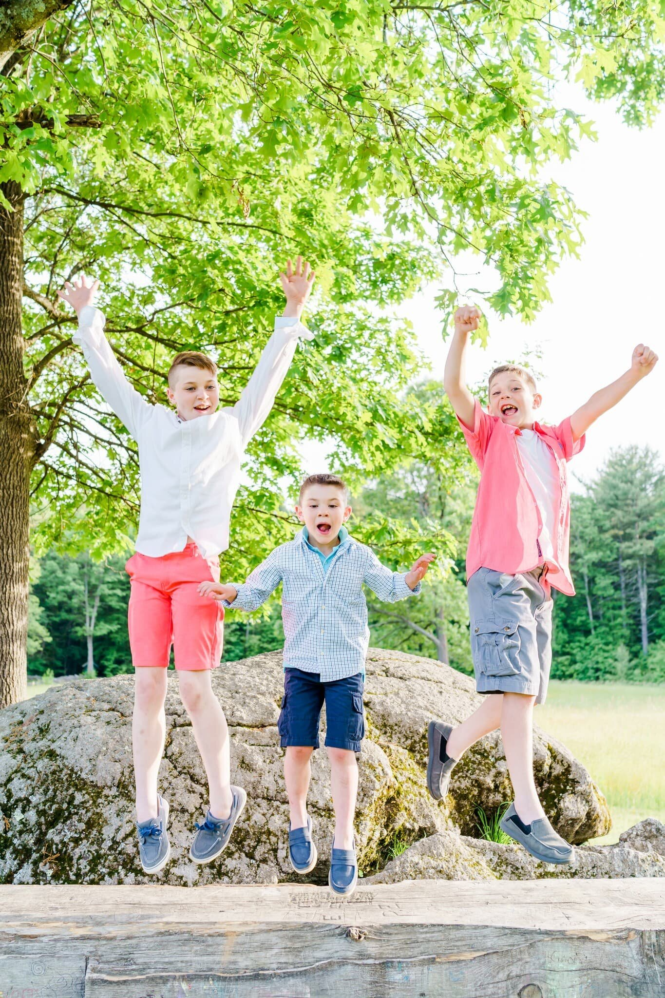 Boys jumping in the air excited for New Hampshire family photos