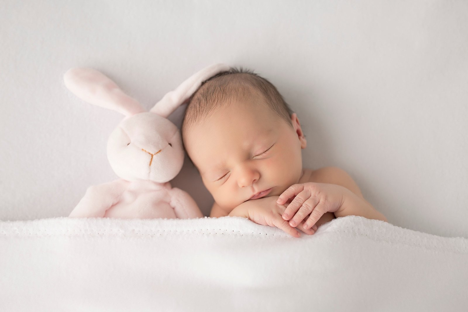 Sleeping baby with bunny