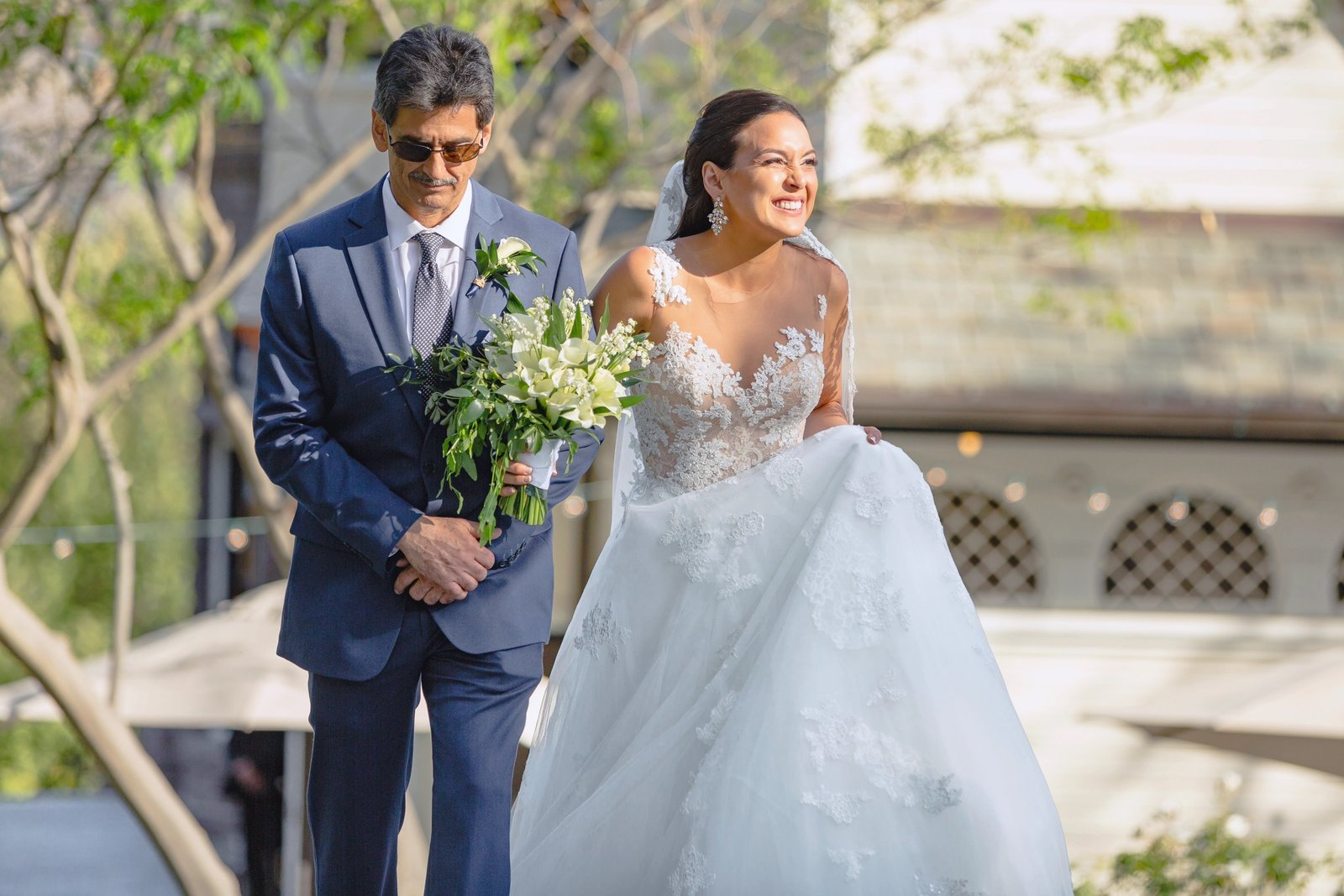daniella and her father walkdown the aisle at the newhall mansion wedding venue