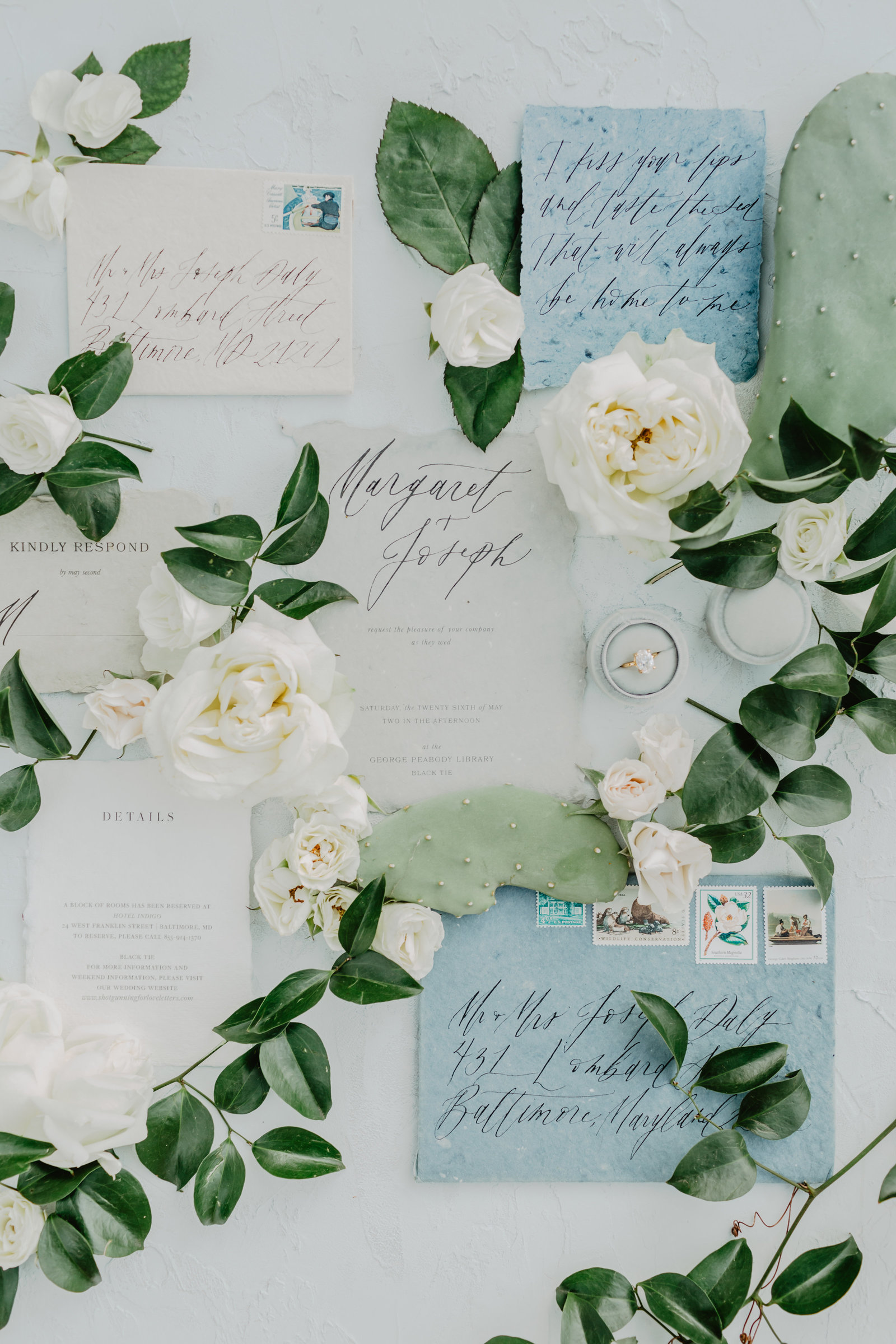 Romantic inspired wedding invitation suite with green floral accents.