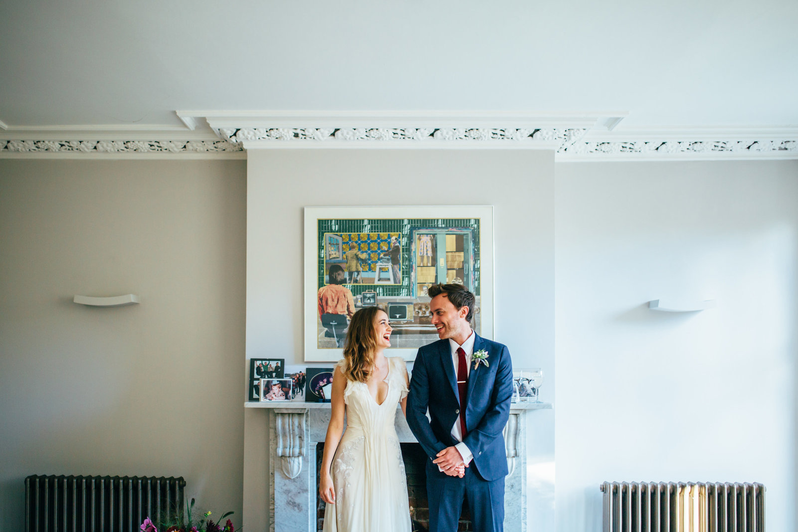 Relaxed Photograph of Suffolk Wedding Couple Laughing indoors in Norfolk