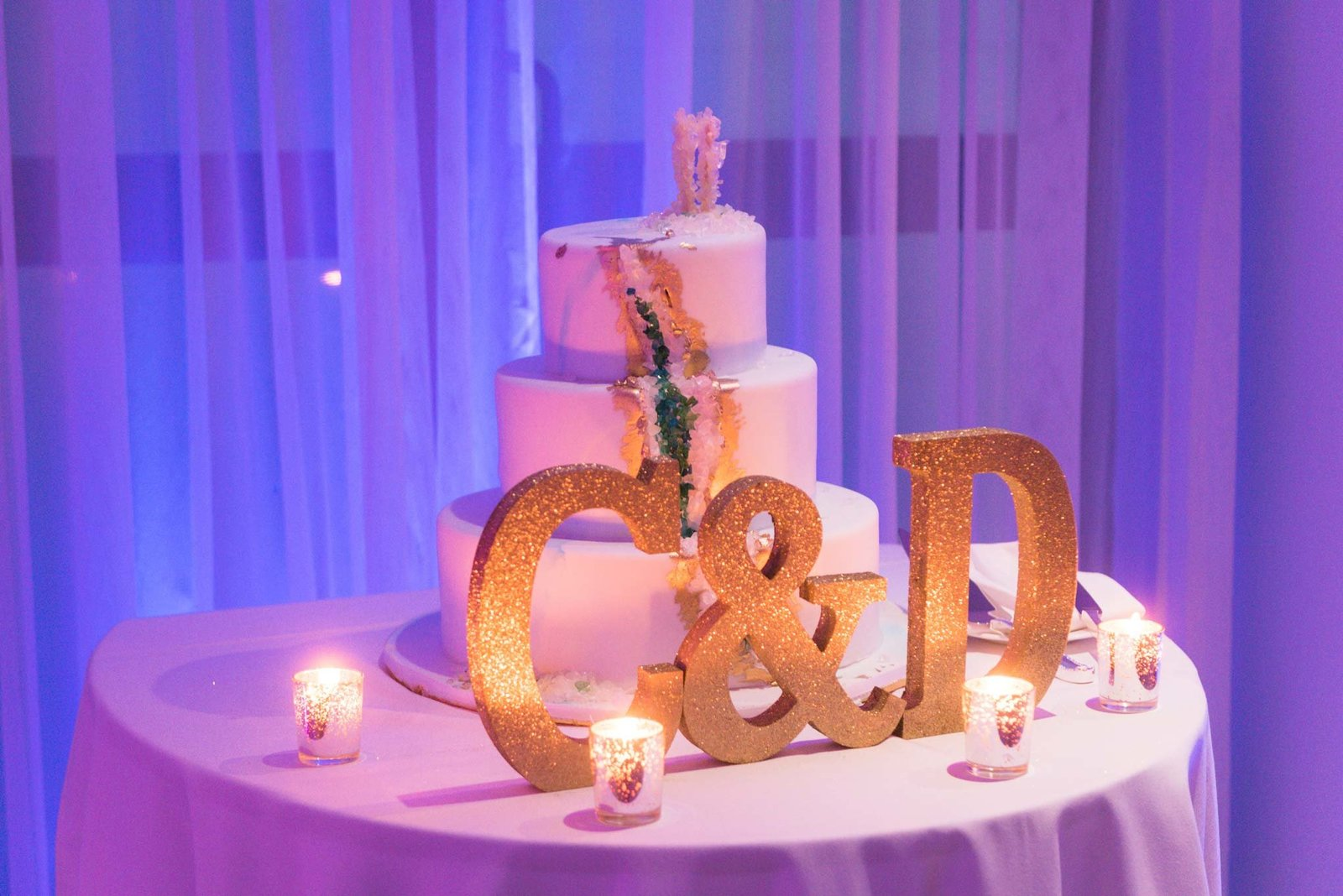 Wedding cake with initials at  Allegria Hotel