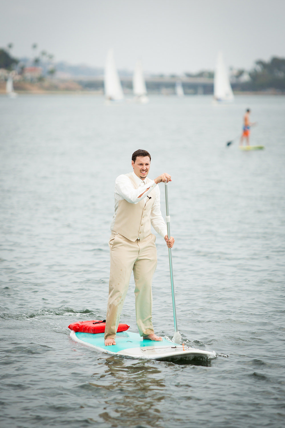groom on a paddle board