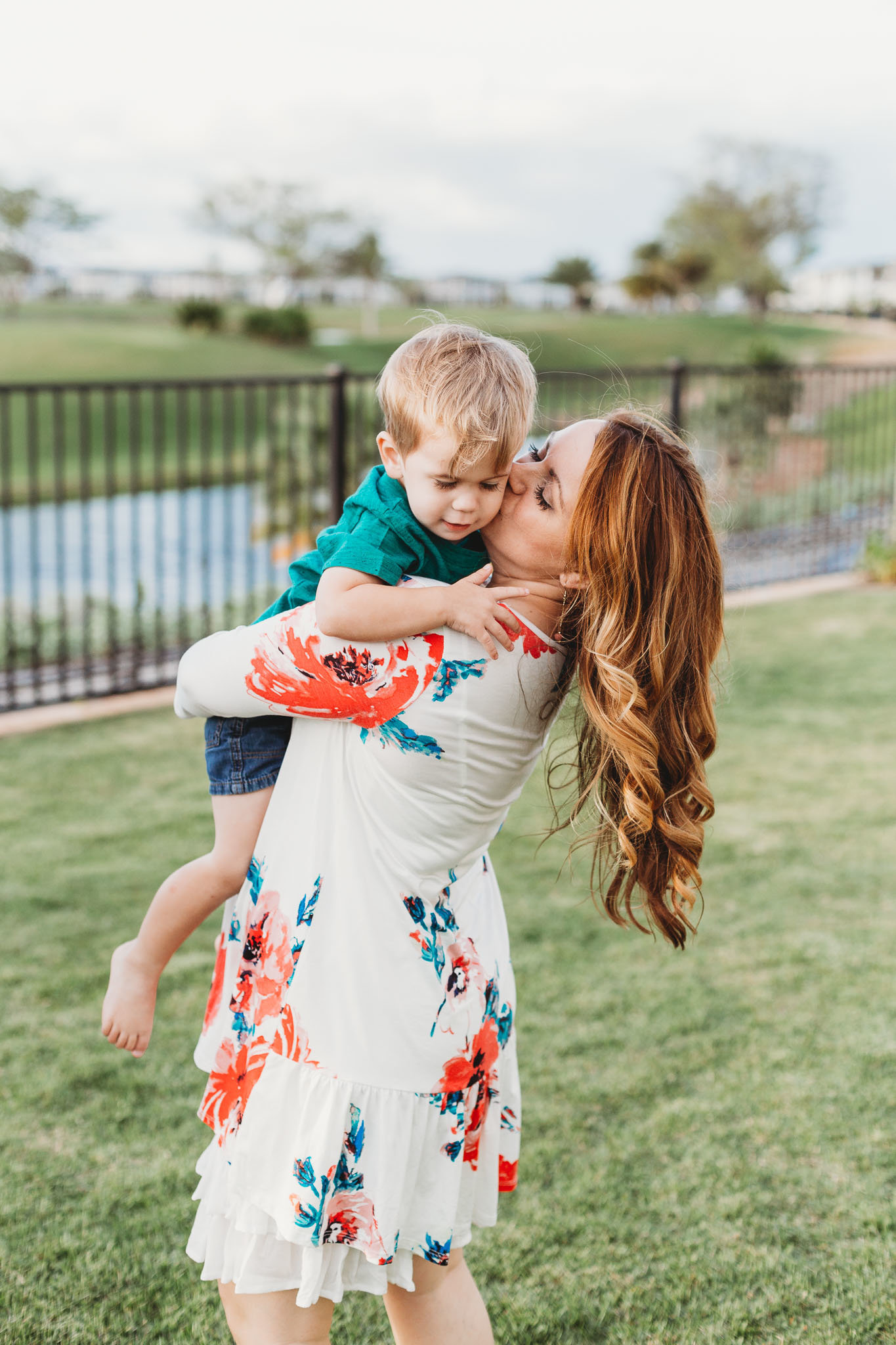 Oahu, Hawaii Lifestyle Photographer - Lifestyle Photography - Brooke Flanagan Photography - Mother kissing son on cheek