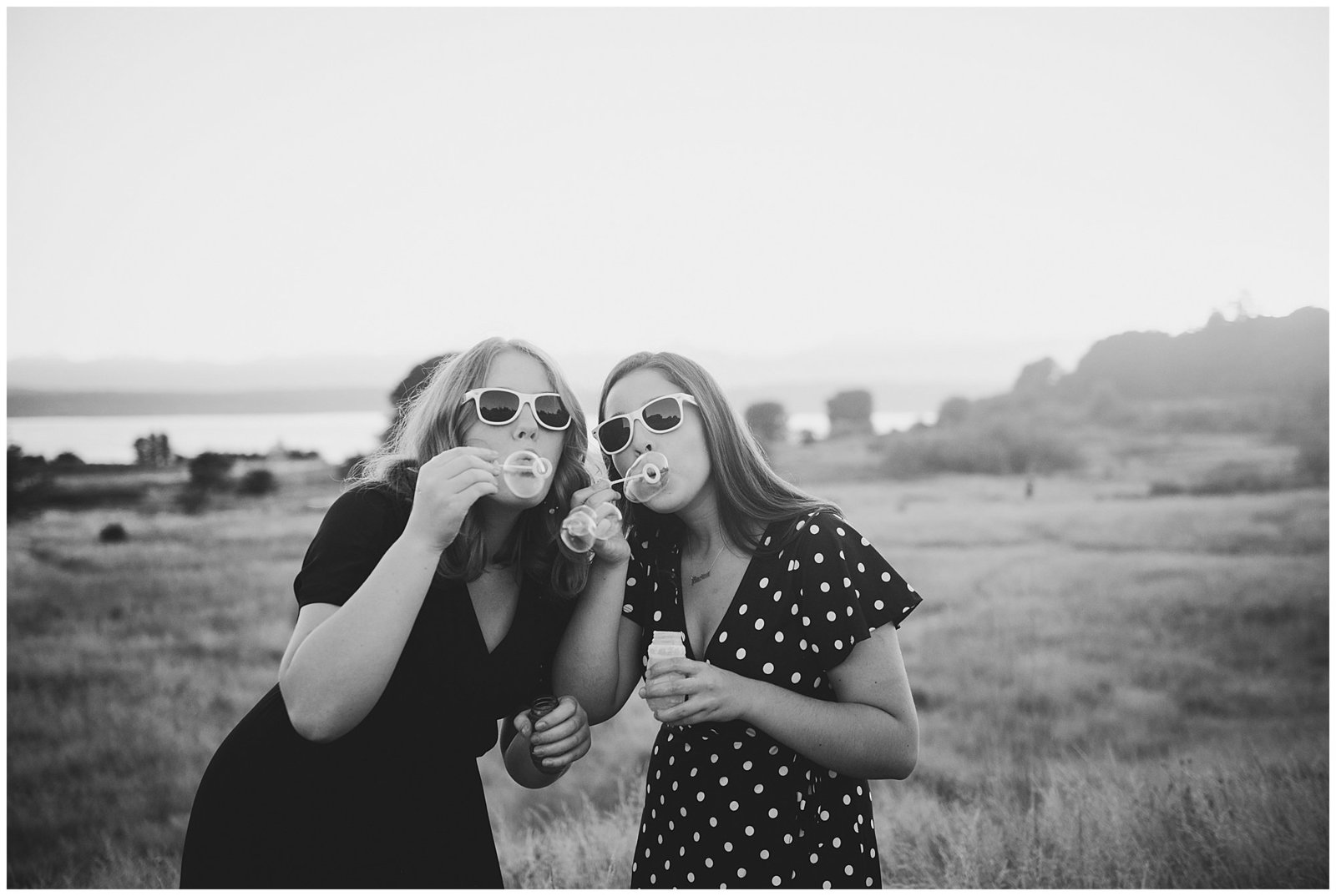 Two senior girlfriends Graduation photos blowing bubbles Emily Ann Photography Seattle Photographer