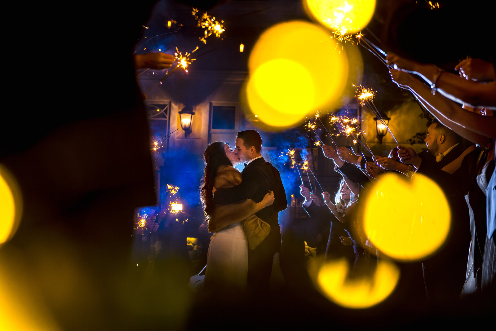 Couple kissing at the end of a sparkler arch exit leaving the rockleigh