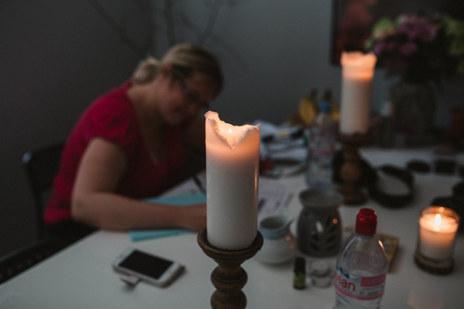 Photo of candles and midwife working at home birth in Ipswich
