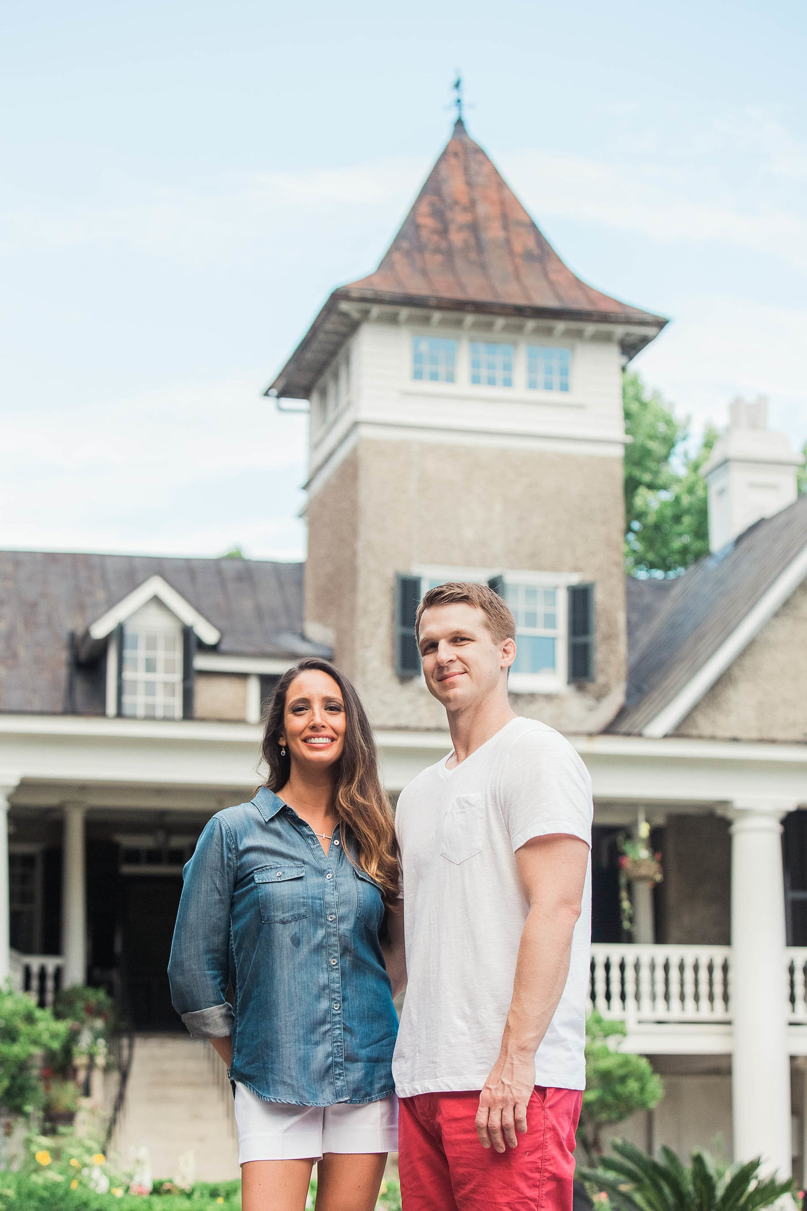 Engaged couple pose in front of mansion, Magnolia Plantation, Charleston, South Carolina