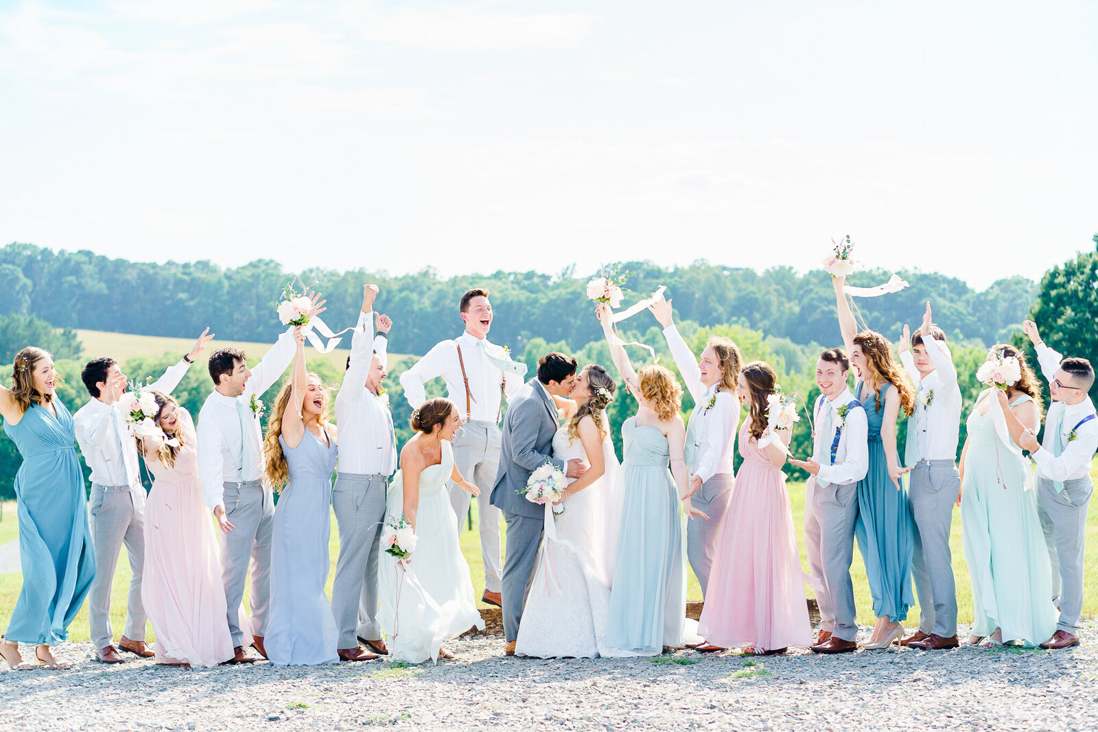 Bridal party celebrating bride and groom in New England wedding