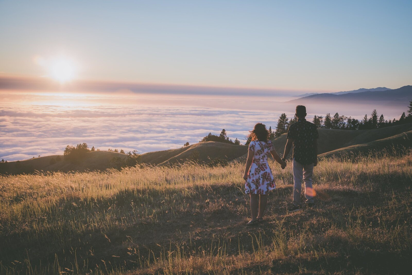 Couple walks off into sunset in Big Sur.