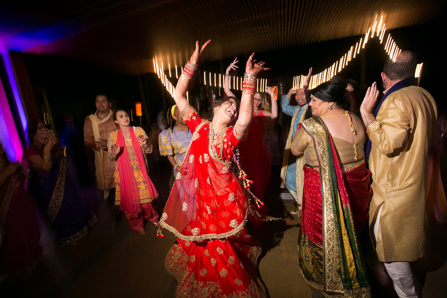 Dancing during the reception party at an Indian wedding