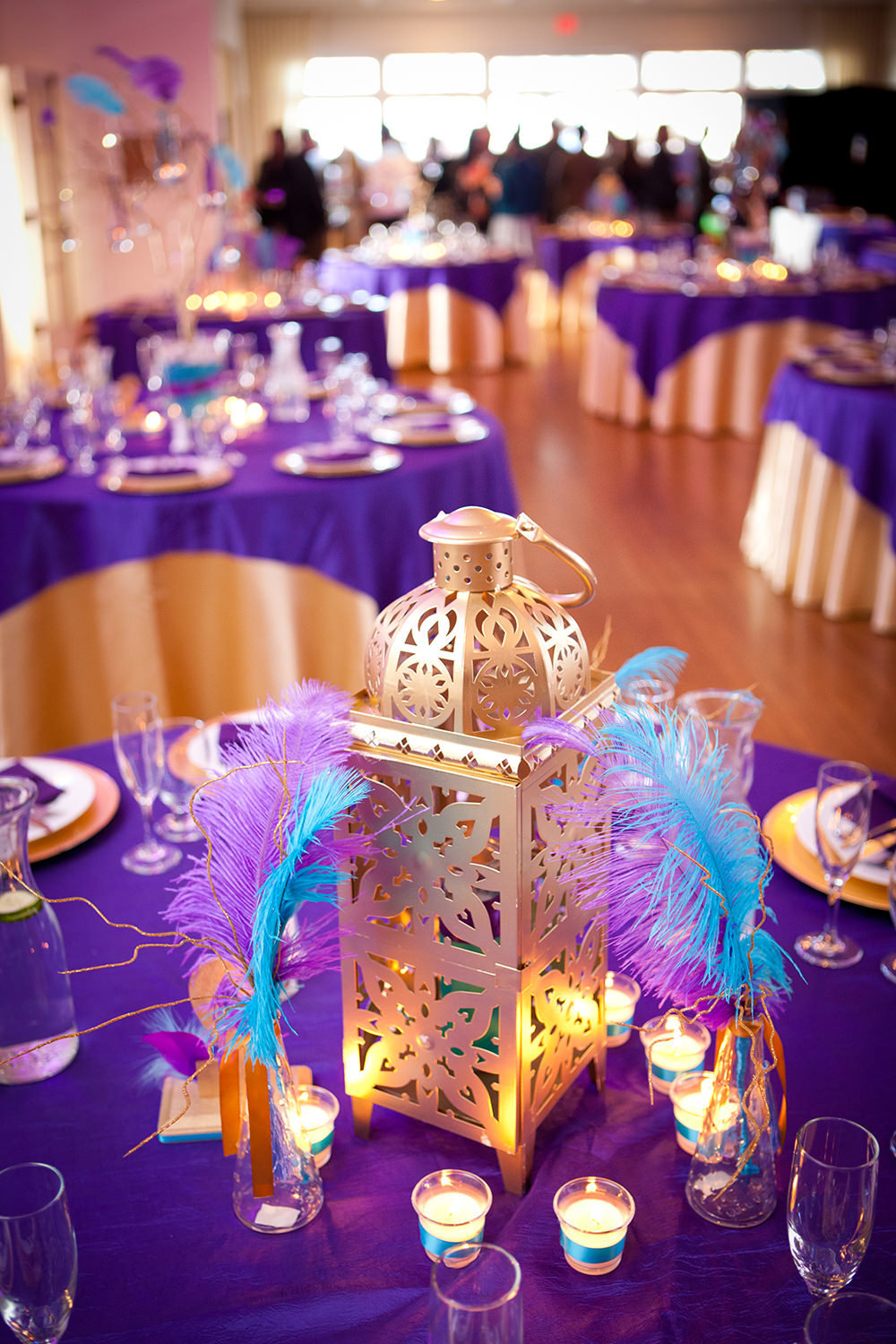 fun reception centerpiece with feathers