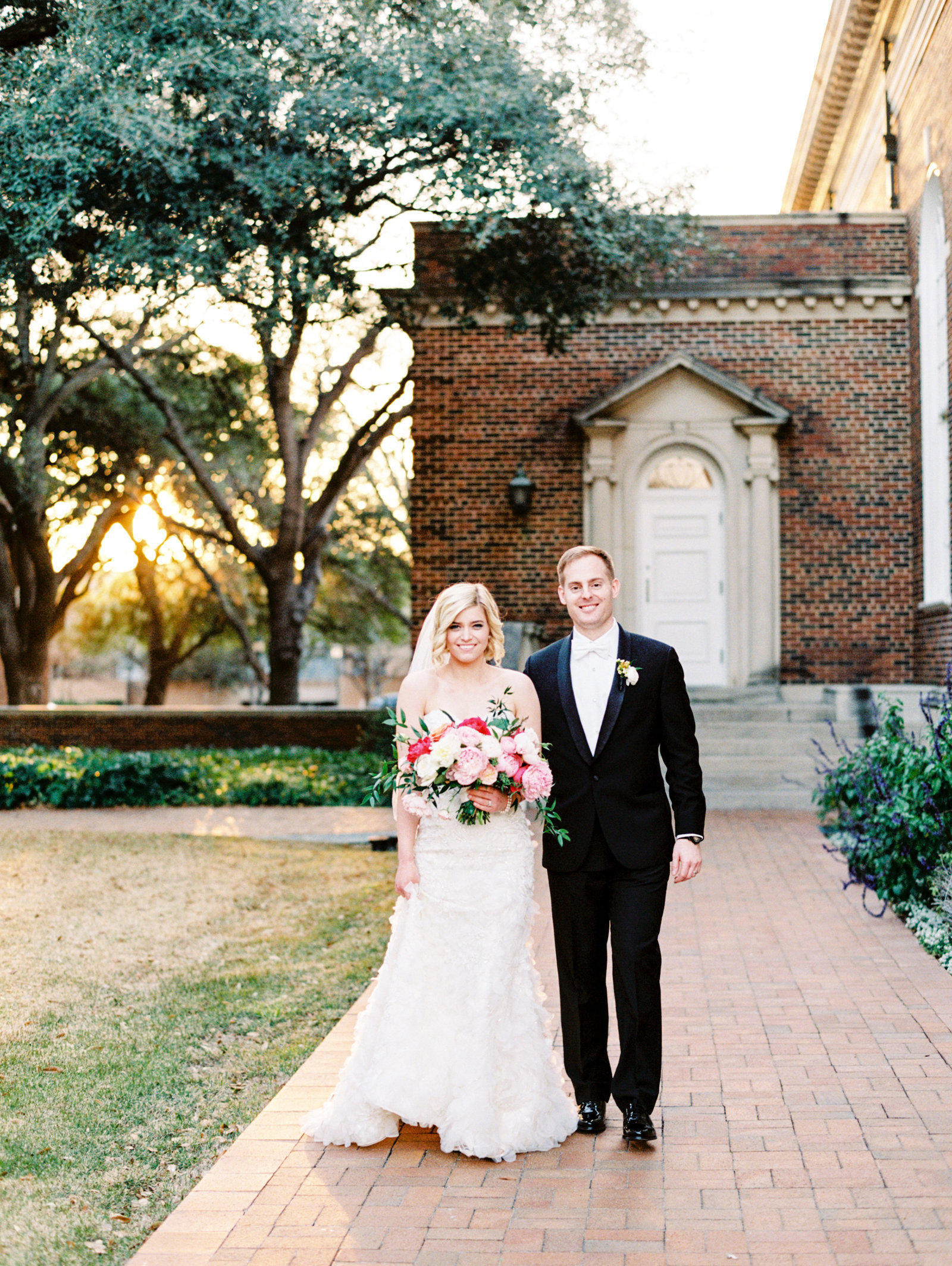 bride and groom outside perkins chapel in highland park texas
