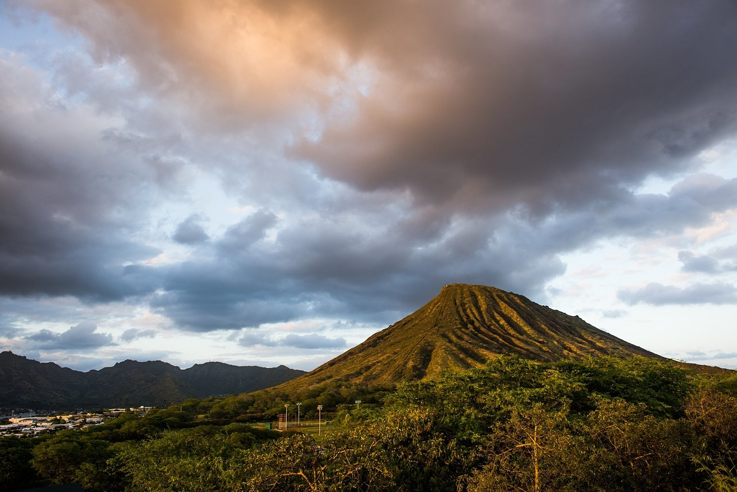 Sunset and dramatic clouds over Koko Head in Hawaii
