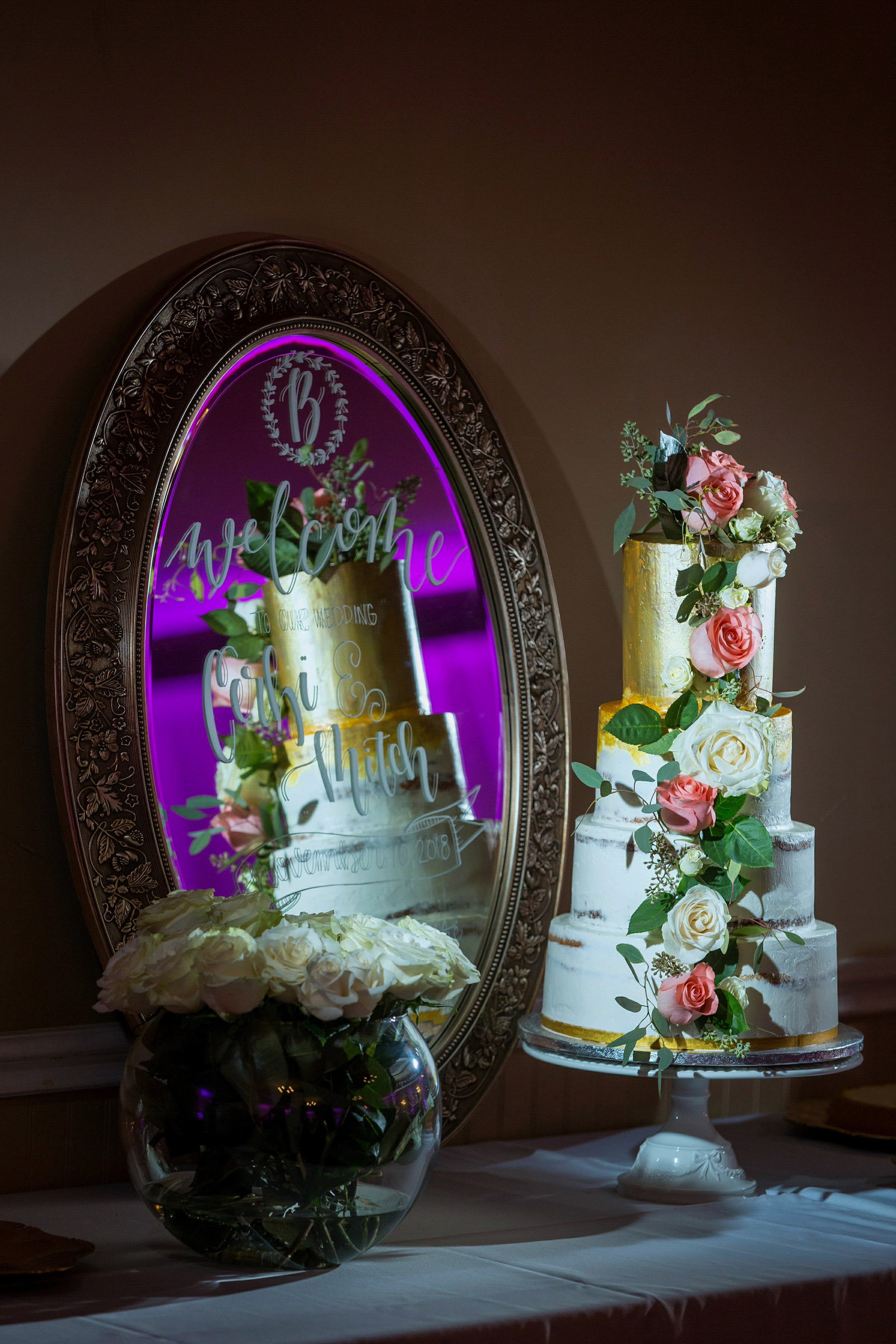 beautiful wedding cake and reflection at pecan plantation granbury
