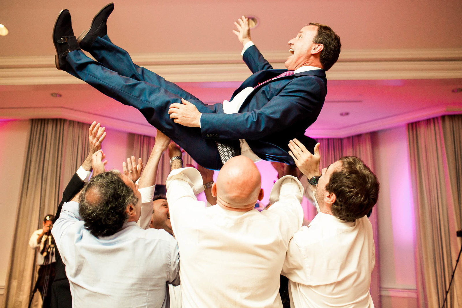 Guests are tossed in the air at reception, Daniel Island Club, Charleston, South Carolina