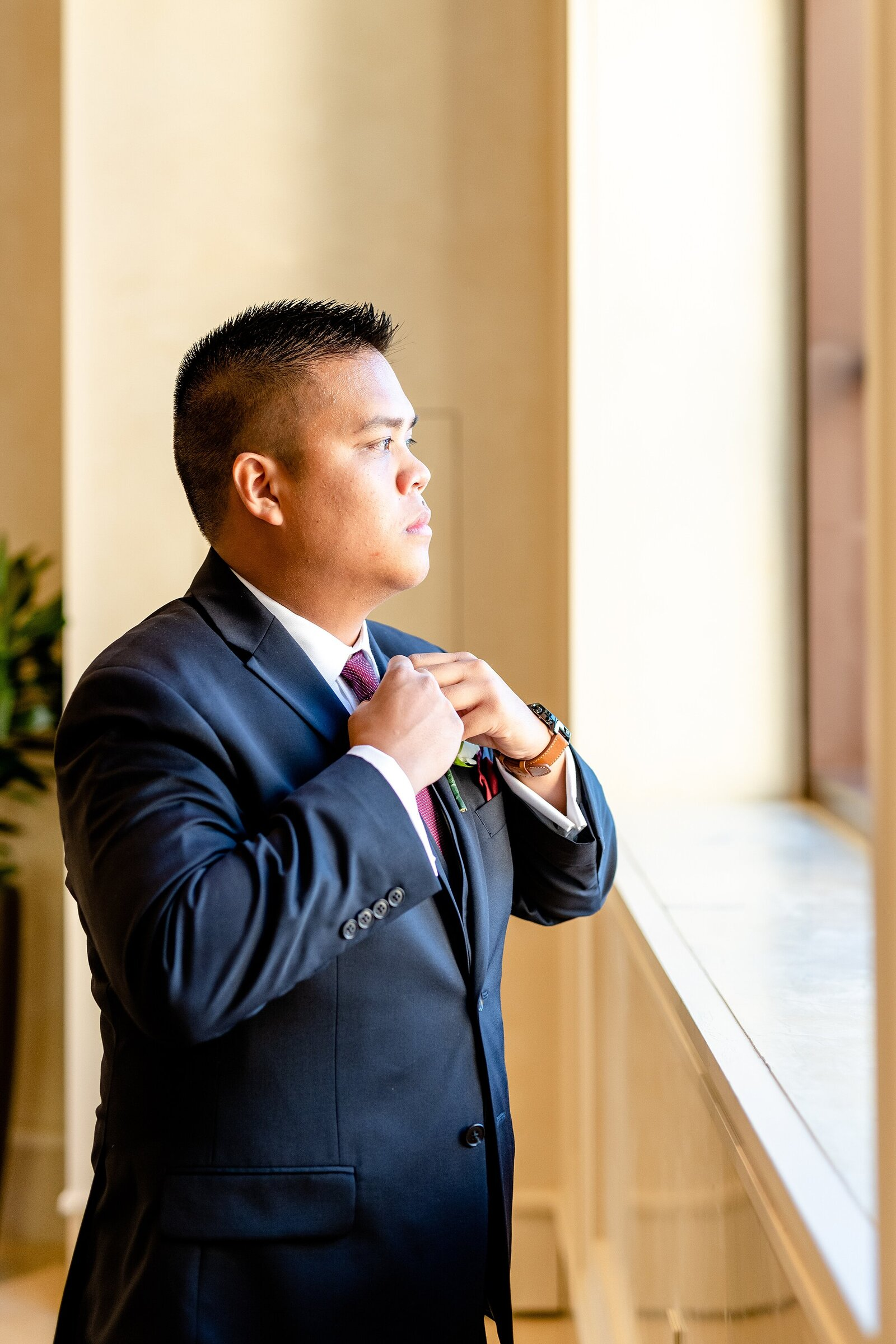 Groom getting ready | Four Seasons Wedding | Chynna Pacheco Photography